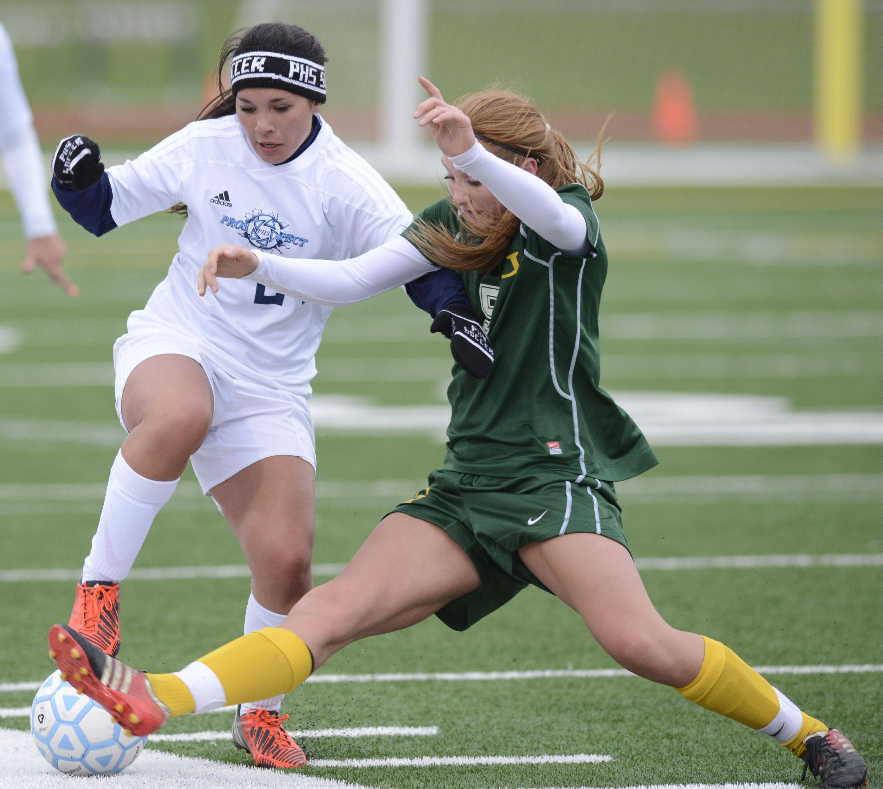 Prospect�s Elena Cukurs, left, and Elk Grove�s Kelly Naughton charge toward the ball Friday at Prospect.