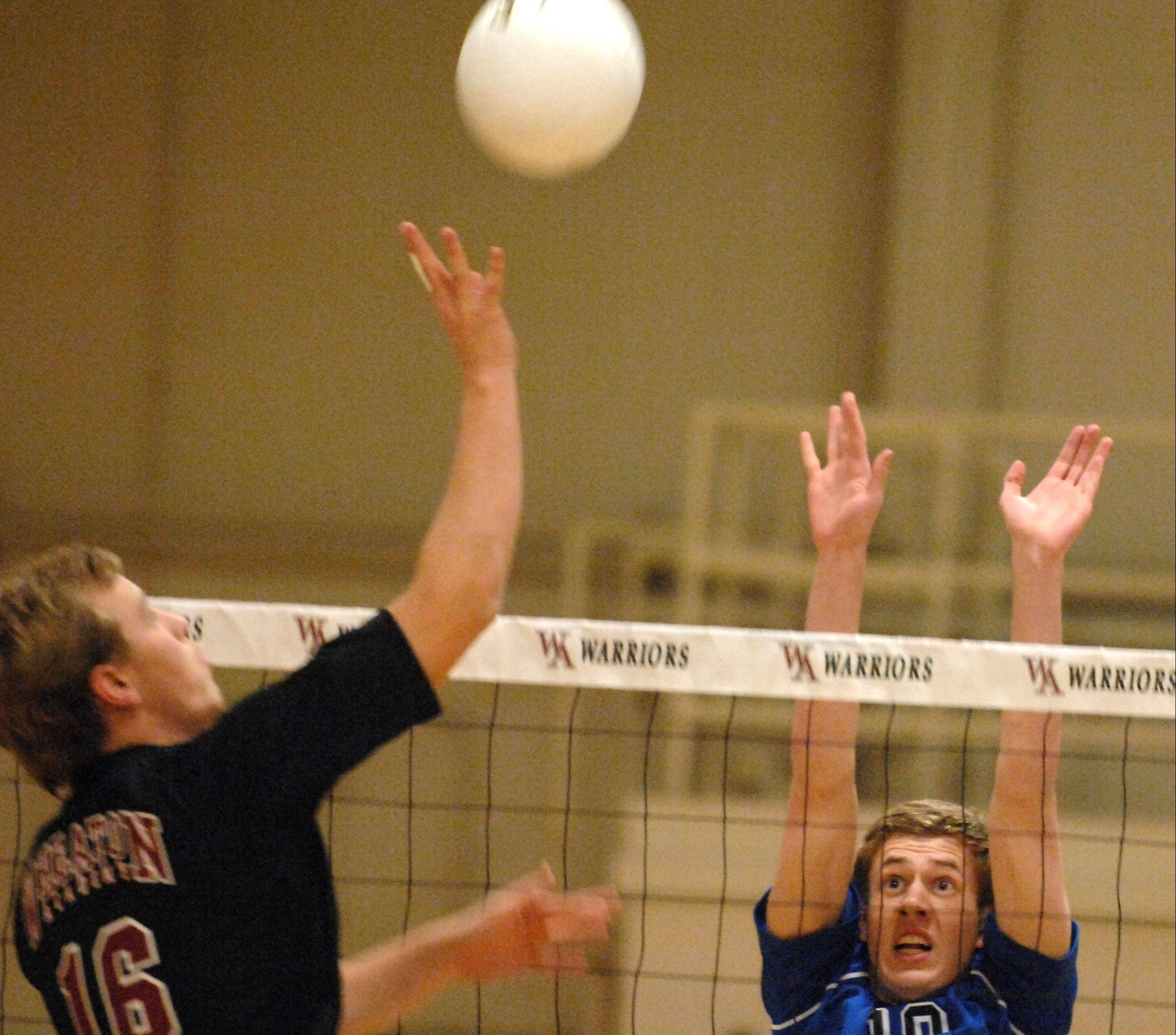Geneva�s Nathan Jesko goes up to block a shot by Wheaton Academy�s Spencer Graf Friday.