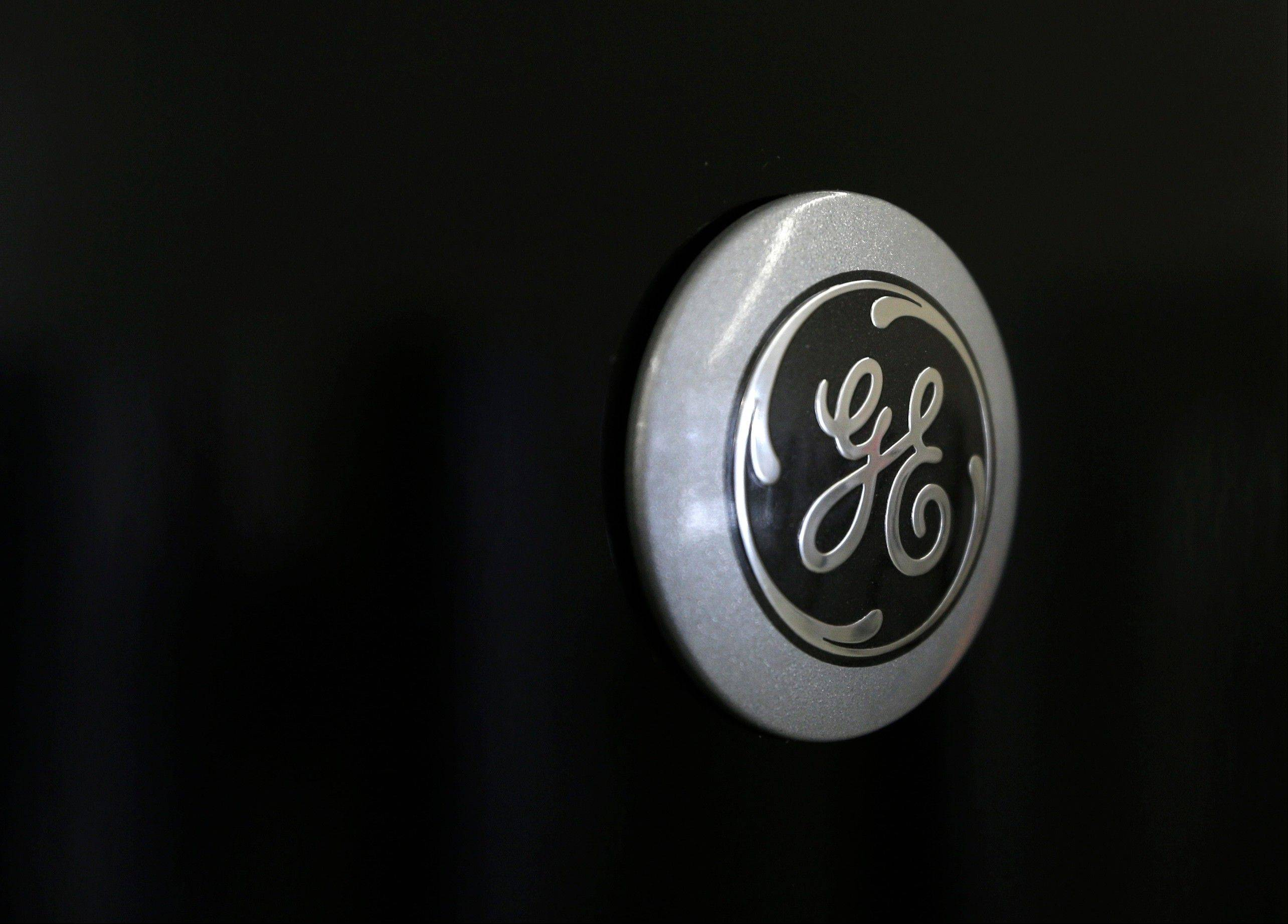GE says net income rose 16 percent in the first quarter, helped by improved profit from selling aircraft engines and transportation equipment and a gain from its sale of NBC Universal.