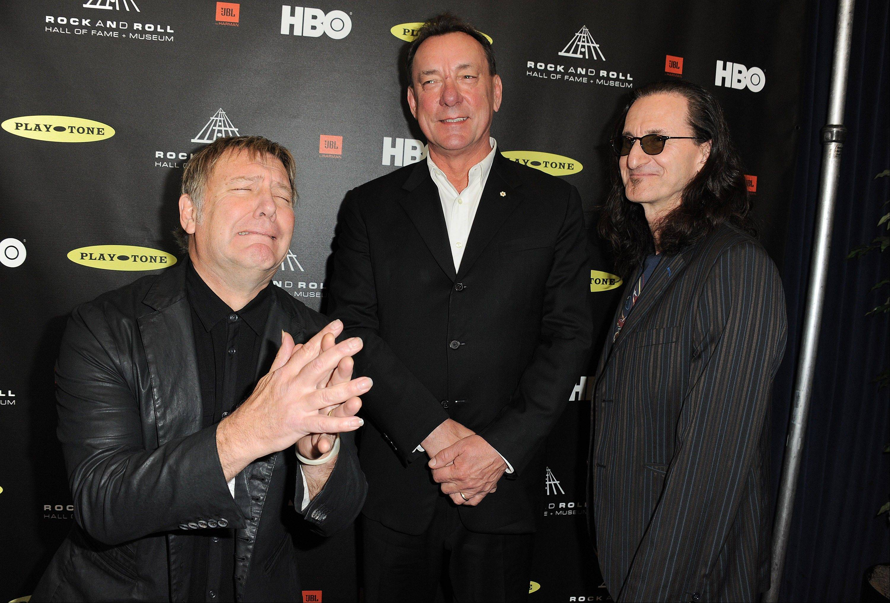 Alex Lifeson, left, Neil Peart, and Geddy Lee of Rush attend the Rock and Roll Hall of Fame Induction Ceremony at the Nokia Theatre on Thursday in Los Angeles.
