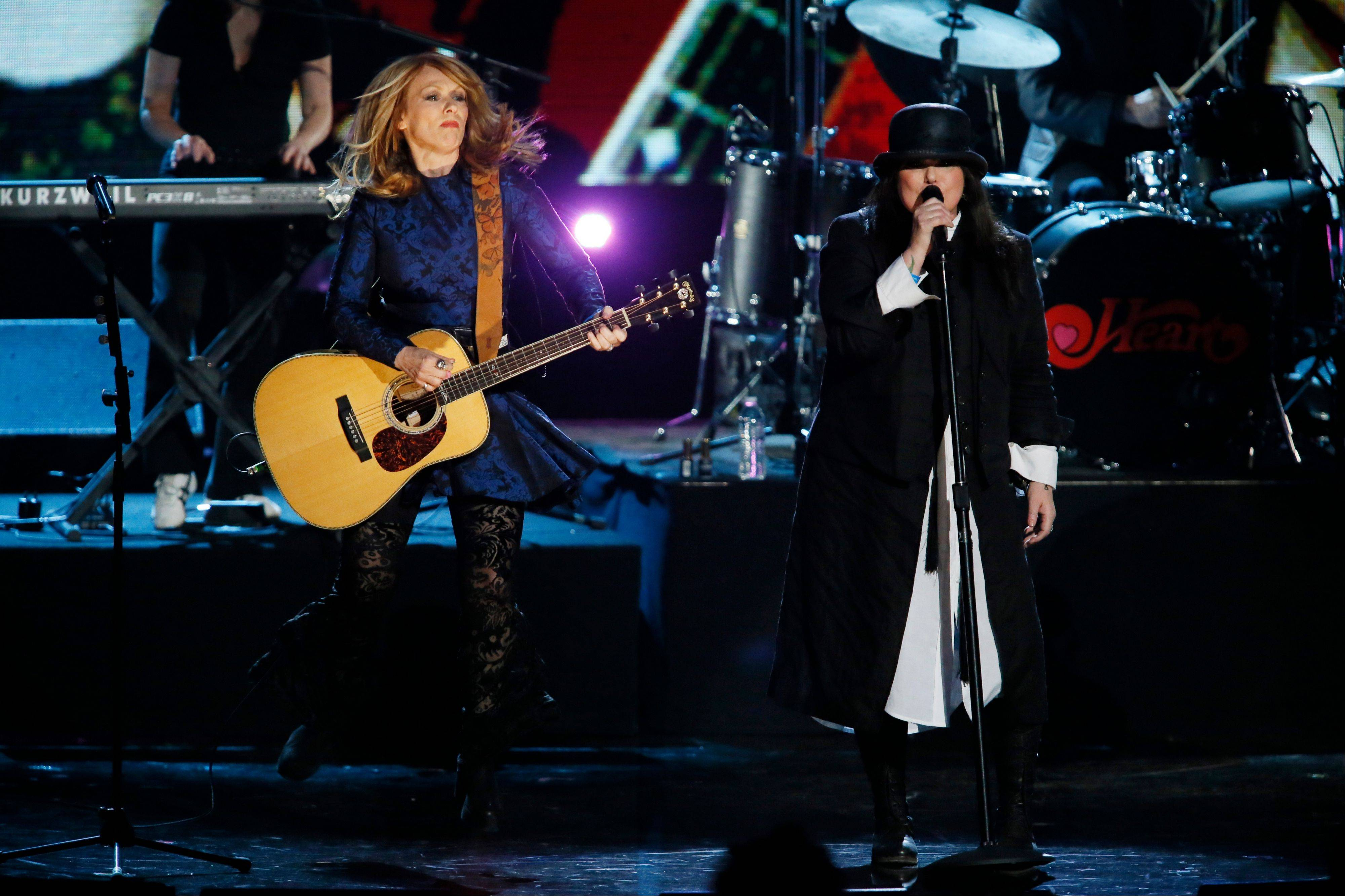 Nancy Wilson, left, and Ann Wilson of the band Heart perform at the Rock and Roll Hall of Fame Induction Ceremony in Los Angles Thursday.