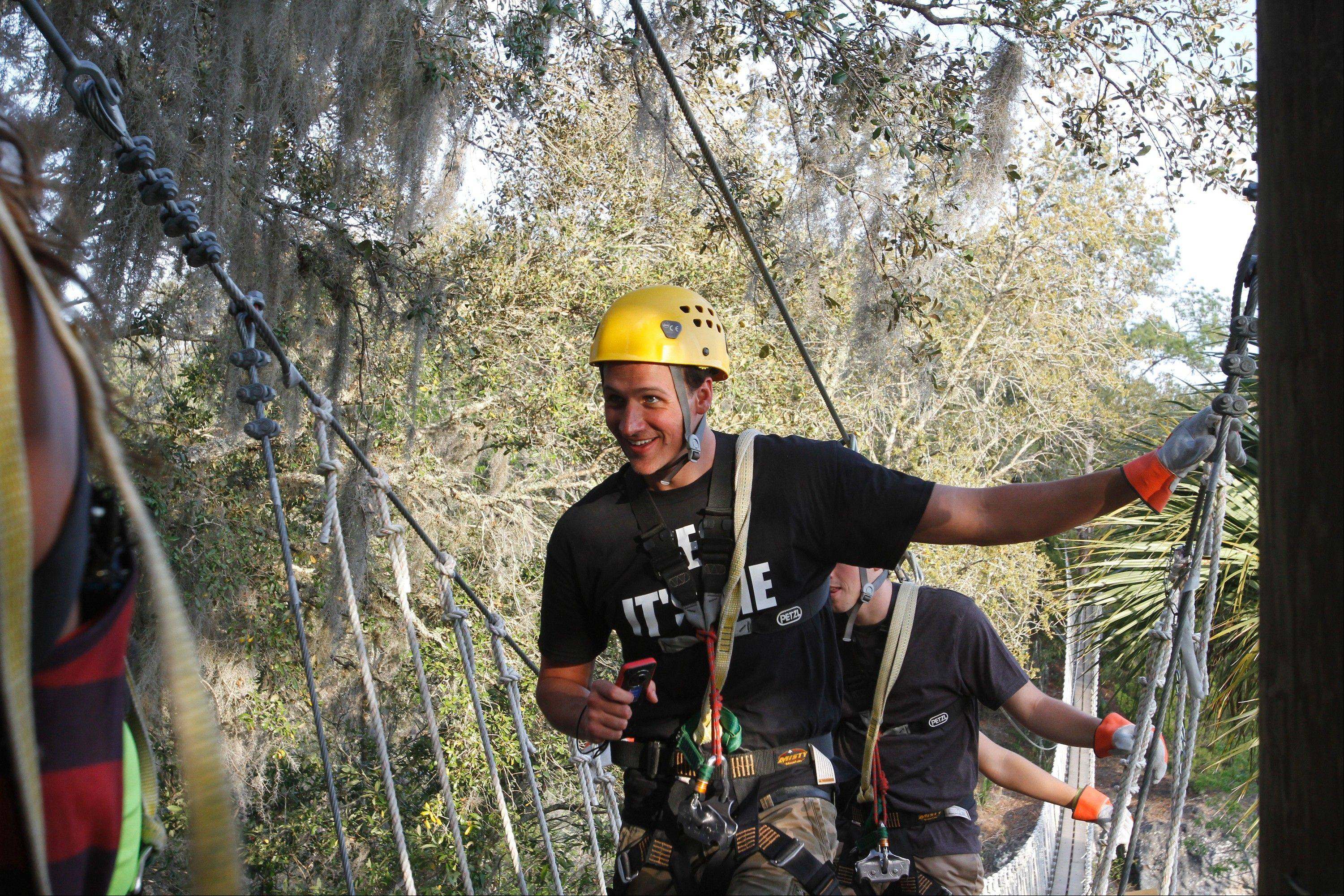 "Olympic swimmer Ryan Lochte goes zip-lining in the E! reality show ""What Would Ryan Lochte Do?"""