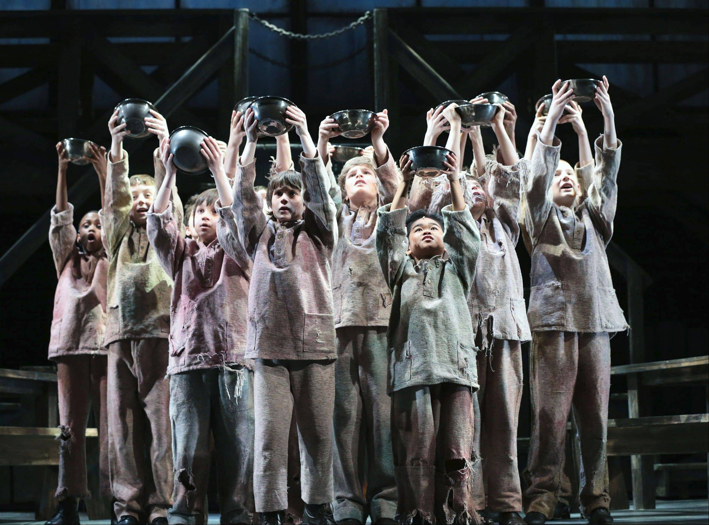 "Workhouse orphans long for ""Food, Glorious Food"" in Lionel Bart's 1960 musical ""Oliver!"" inspired by Charles Dickens' ""Oliver Twist"" at Drury Lane Theatre in Oakbrook Terrace."