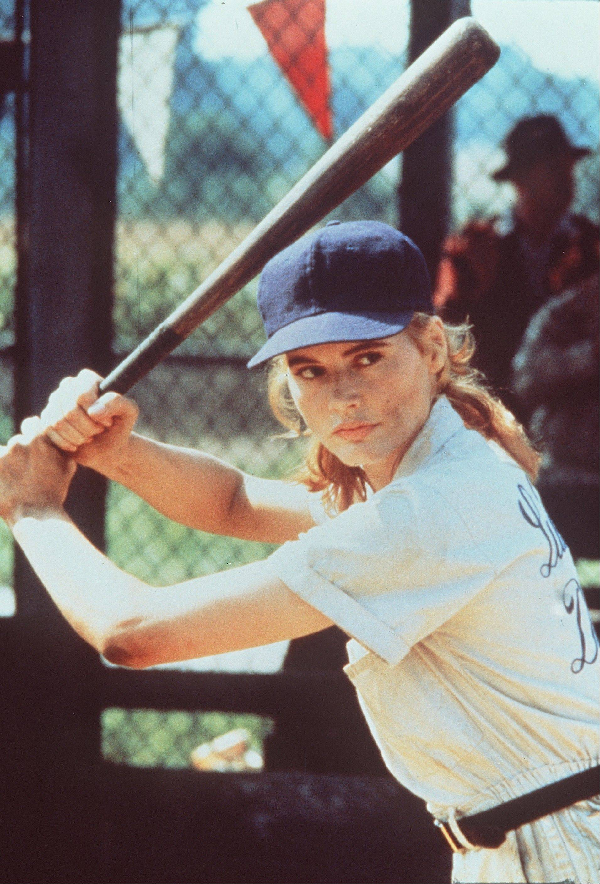 "Geena Davis swings a mean bat as a member of the professional women's baseball league in Penny Marshall's sophisticated comedy ""A League of Their Own."""