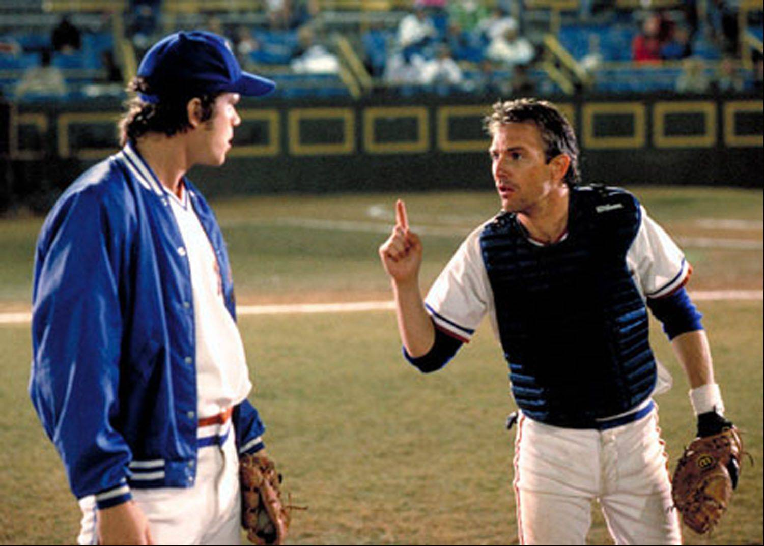 "Crash Davis (Kevin Costner) chews out a potential pitching phenomenon (Tim Robbins) in the superior baseball movie ""Bull Durham."""