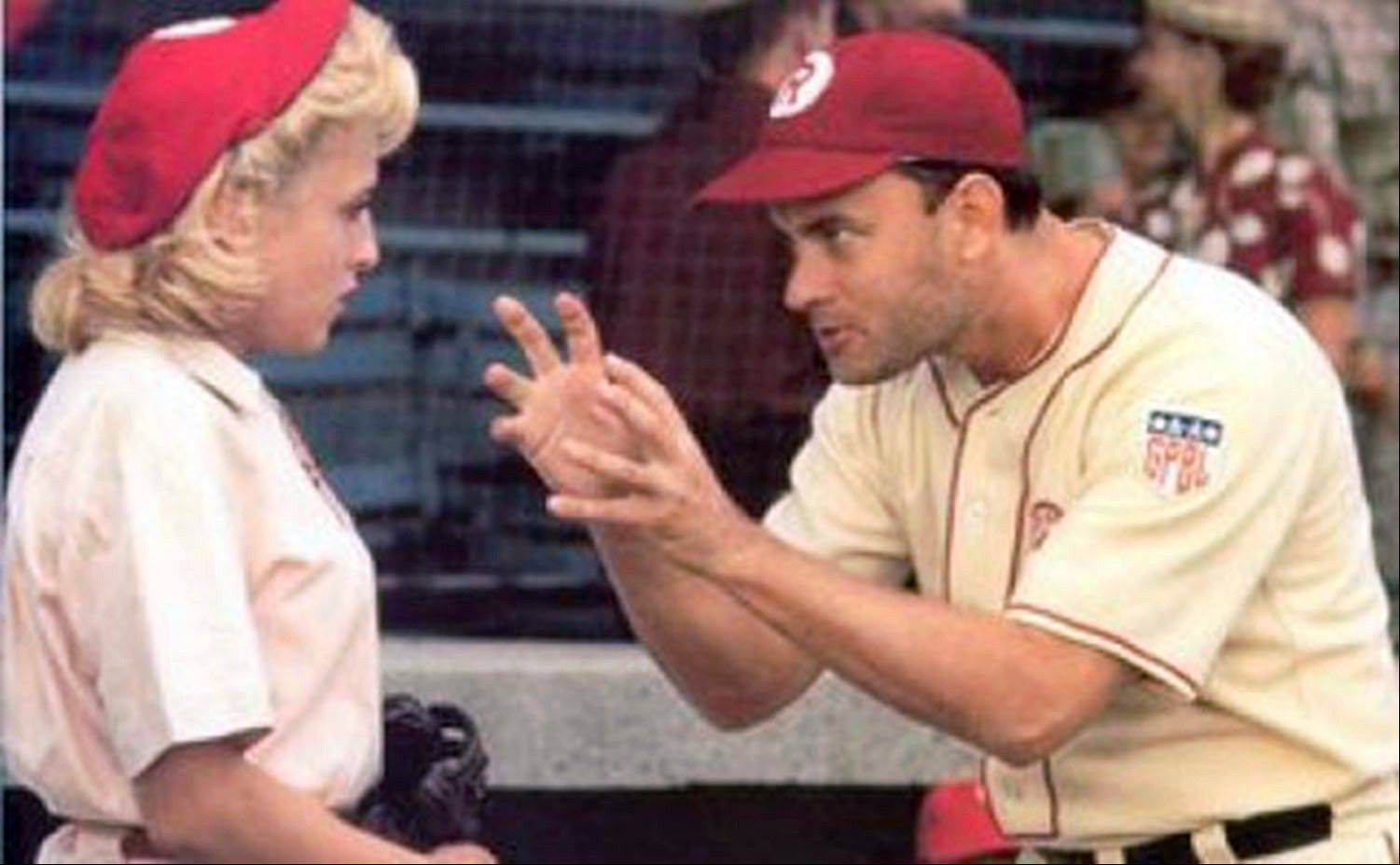 "Manager Jimmy Dugan (Tom Hanks) admonishes Evelyn Gardner (Bitty Schram) with the memorable line, ""There's no crying in baseball,"" in ""A League of Their Own."""