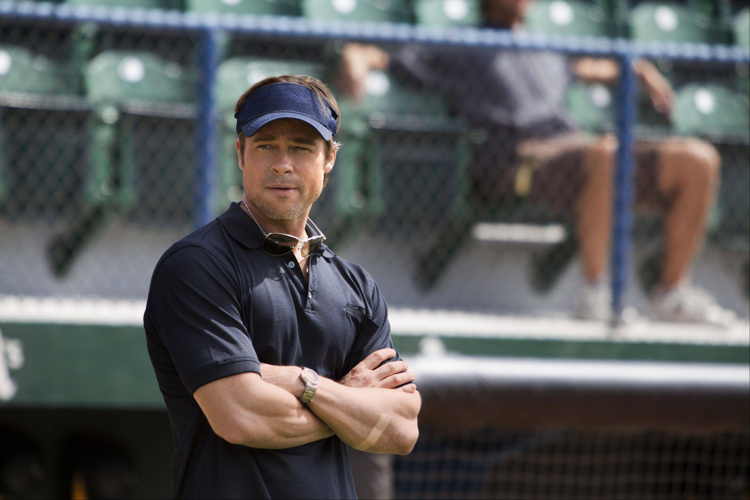 "Oakland A's general manager Billy Beane (Brad Pitt) comes up with an unorthodox way to improve his team in ""Moneyball."""