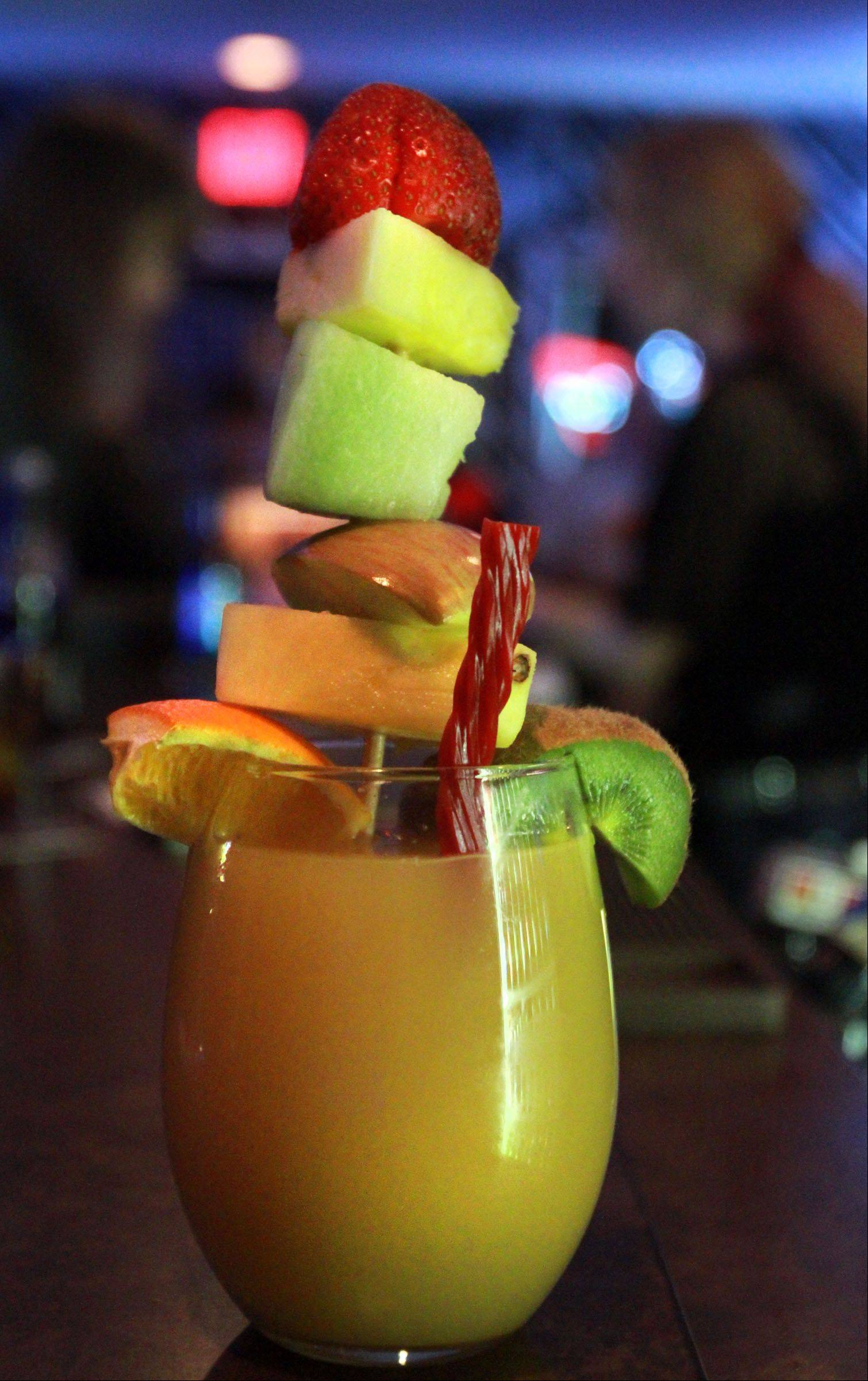 The Monster Mimosa at Route 12 Bar & Grill is part drink -- part snack. It's made with Angry Orchard Hard Cider and orange juice and garnished with fruit and licorice.