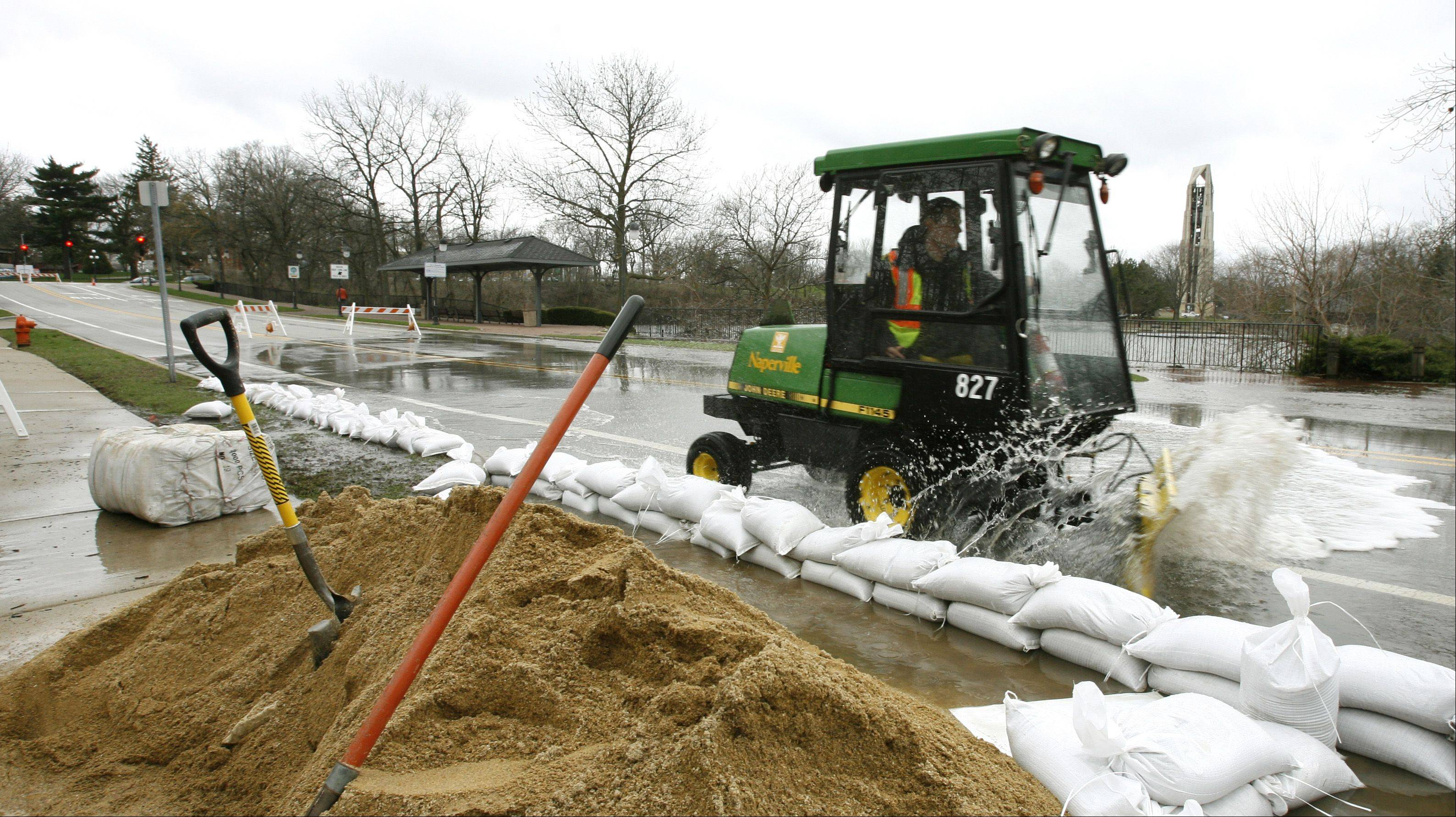 Sandbagging helped mitigate the flooding in downtown Naperville.