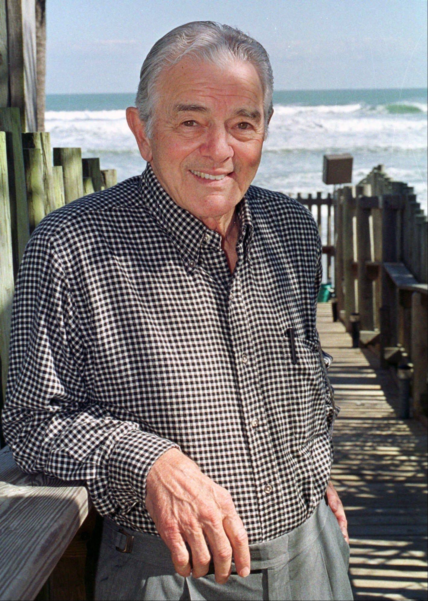 Al Neuharth, founder of USA Today, poses at his home in Cocoa Beach, Fla.
