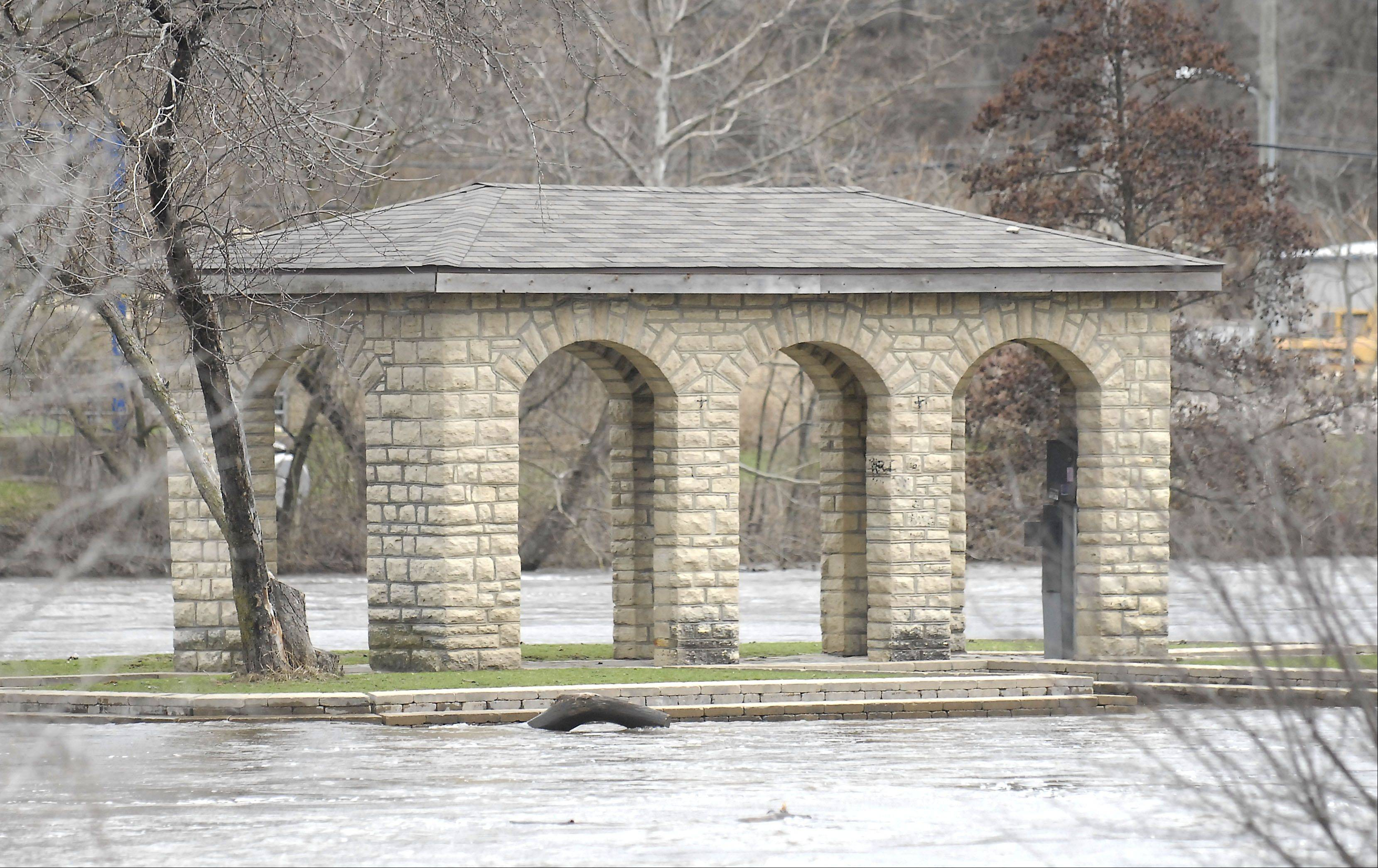 The shelter building on Clark Island Park is surrounded by Fox River floodwaters in Batavia Friday.