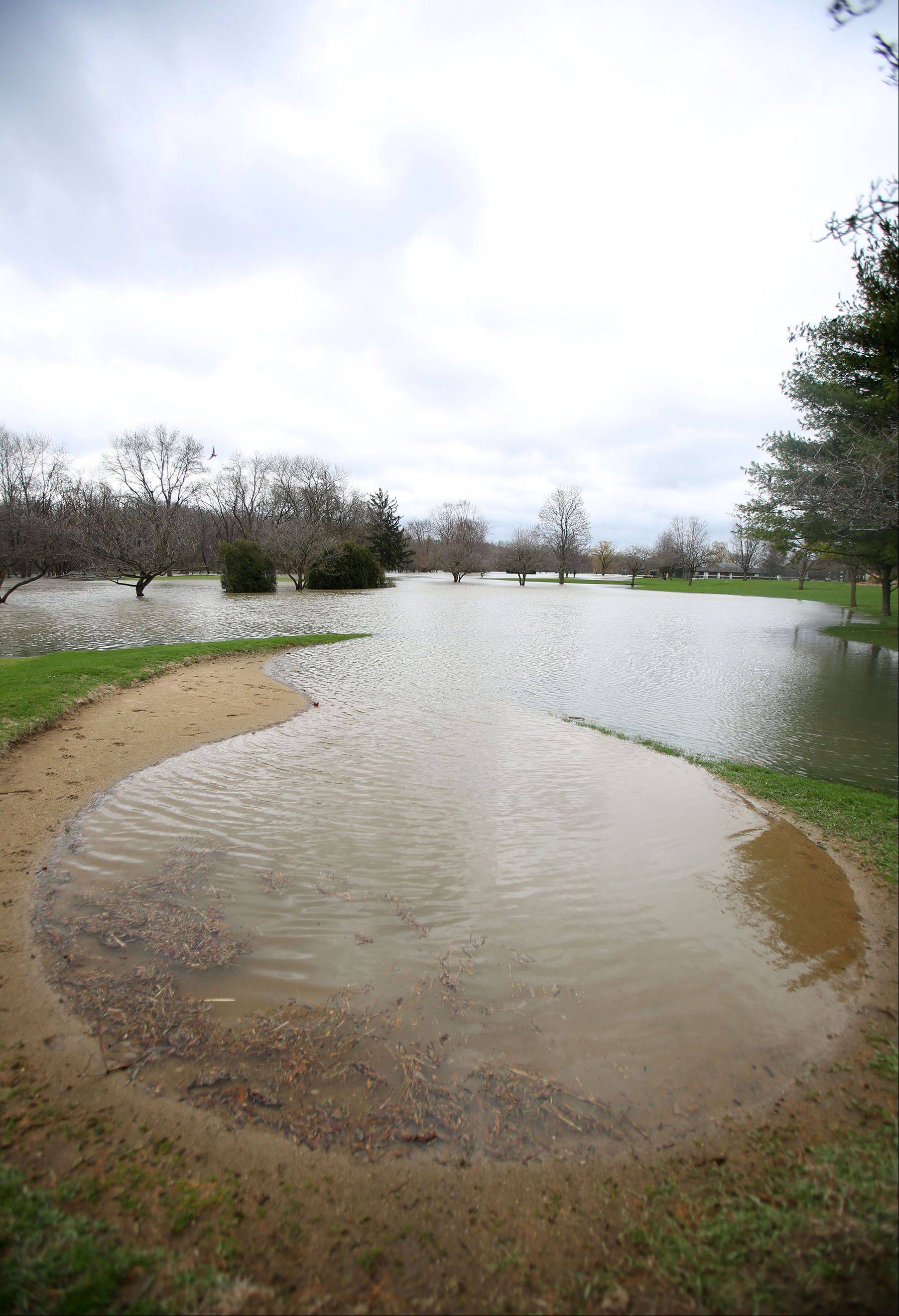 Much of the Riverside Golf Course in Libertyville is under water as the Des Plaines River overflowed it's banks Friday.