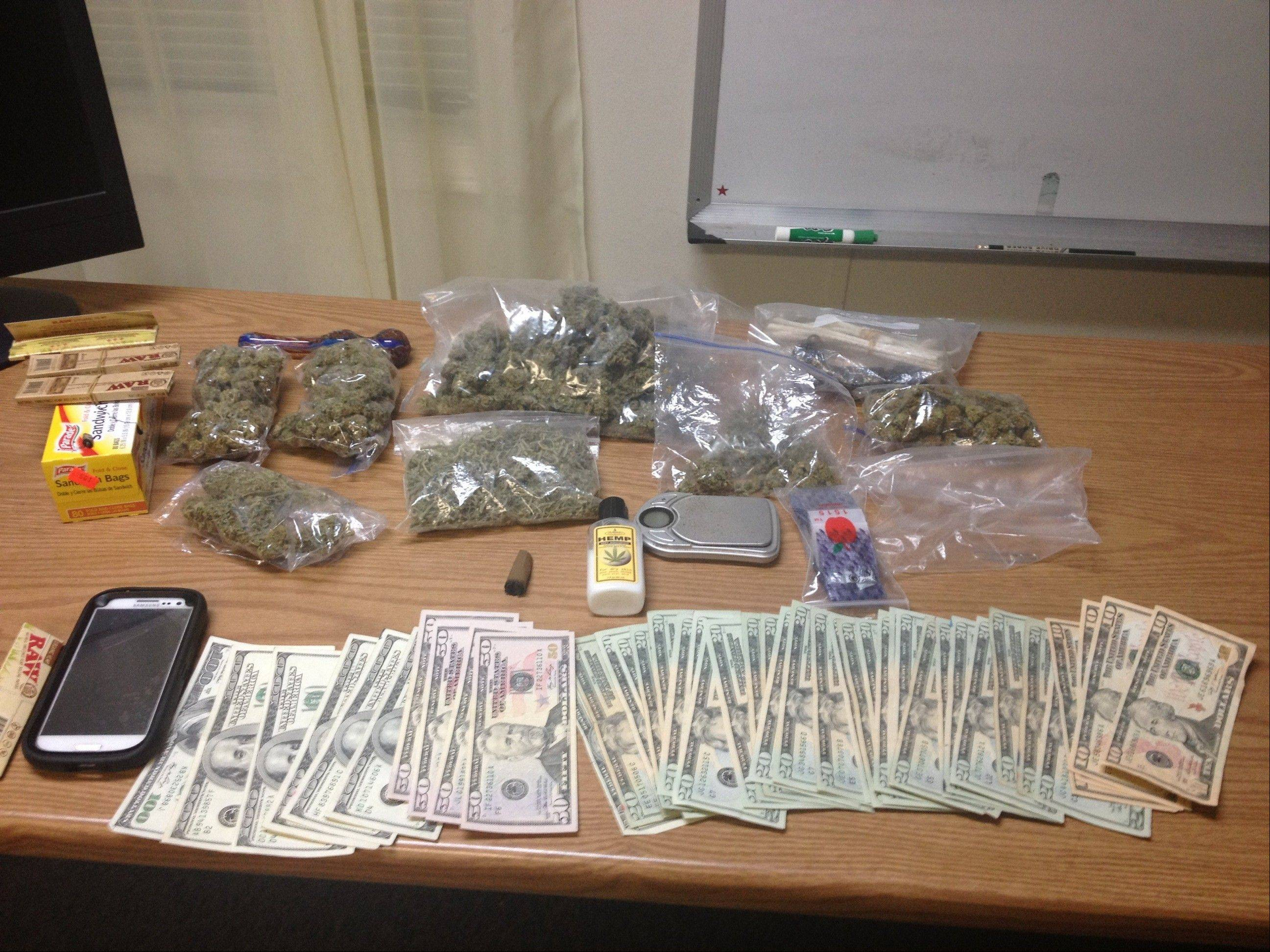Round Lake Park police say they recovered $1,958 in cash, 263 grams of marijuana with a street value of roughly $3,000 and other items from three suspected street gang members facing drug charges.