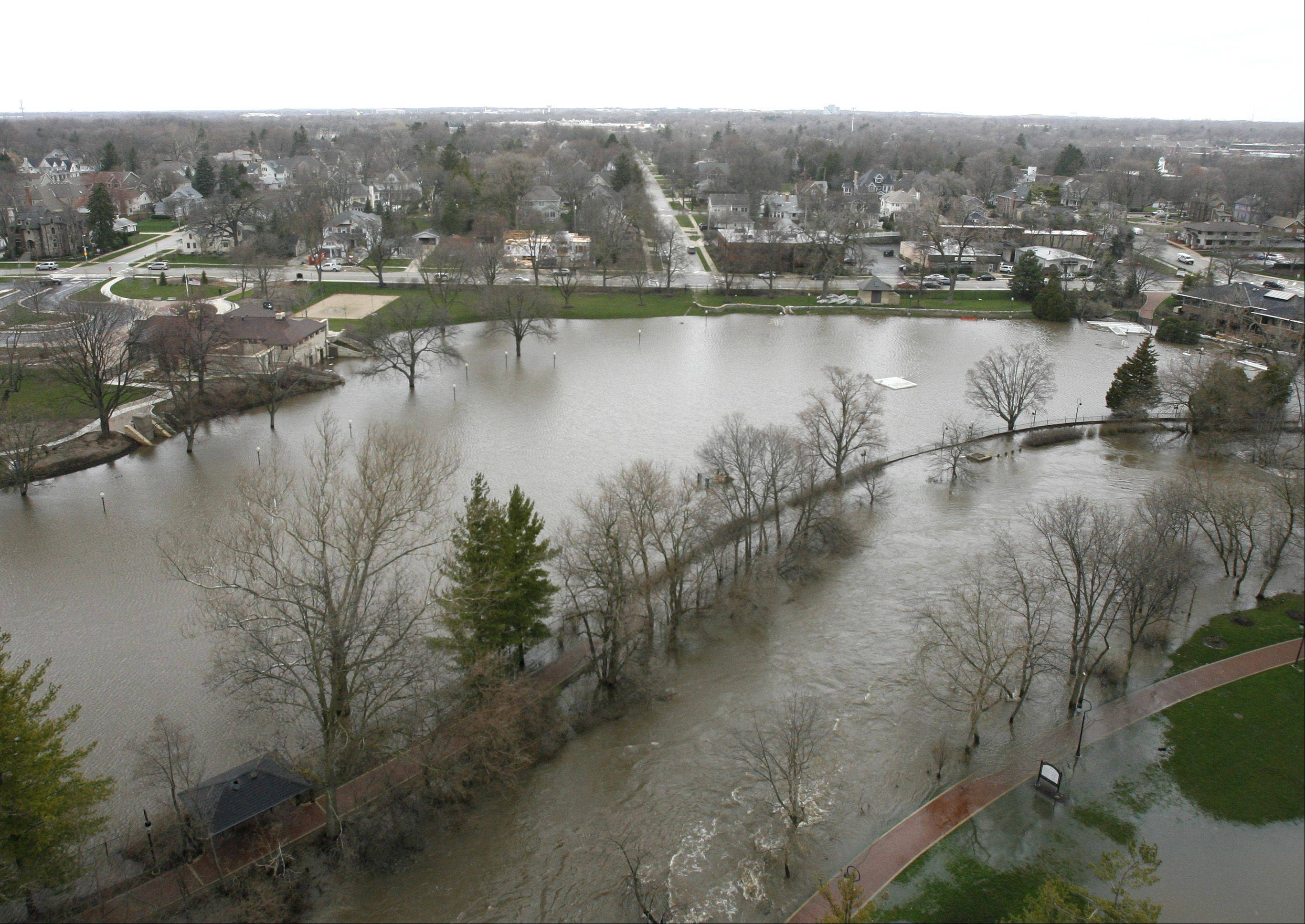 Centennial Beach has more water than it needs, as the city of Naperville works to clean up from ravaging downtown flooding.