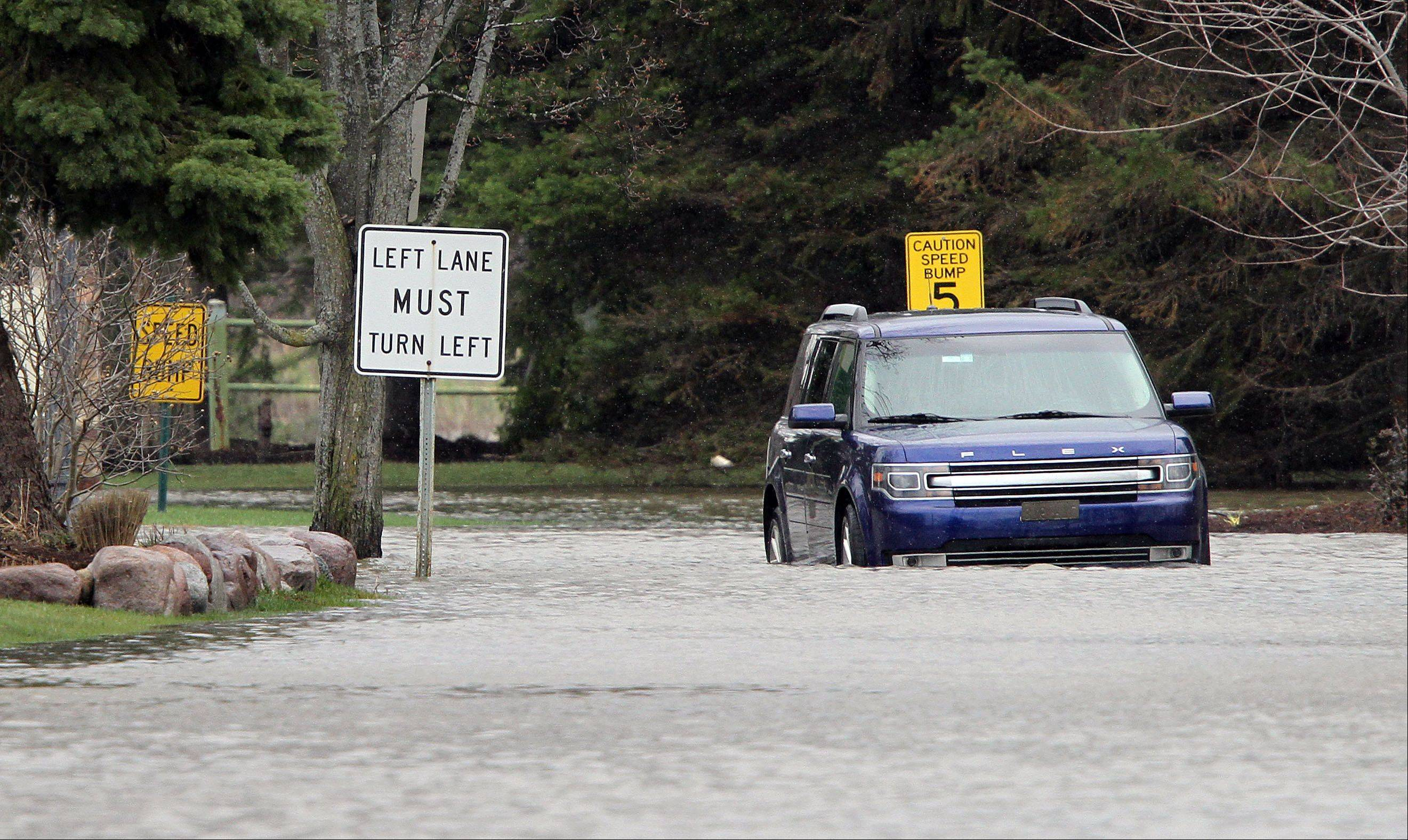 A car sits stranded on the entrance to the Lincolshire Marriott Resort Friday morning.
