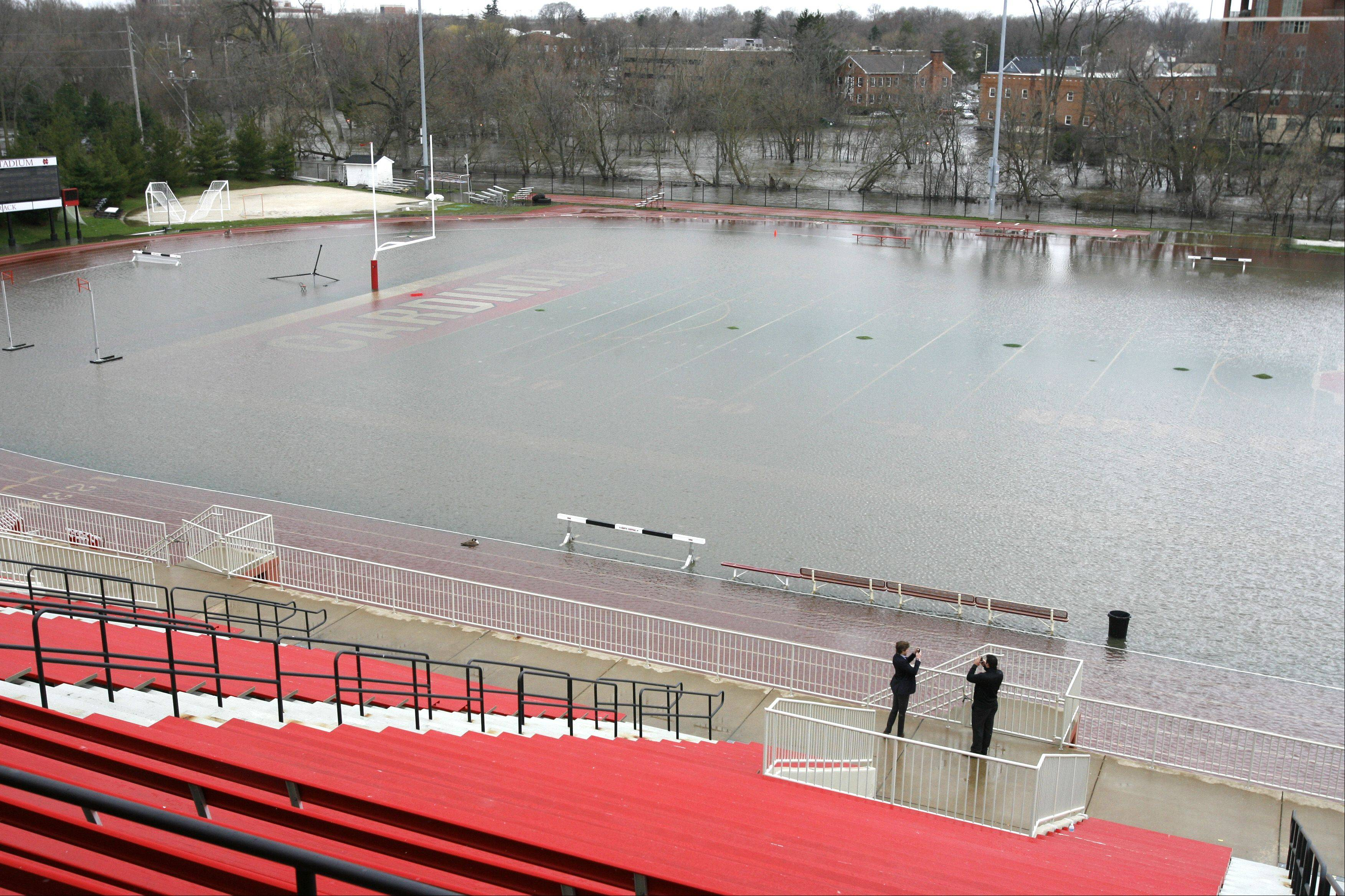 The North Central College athletic field is under water from downtown Naperville flooding.