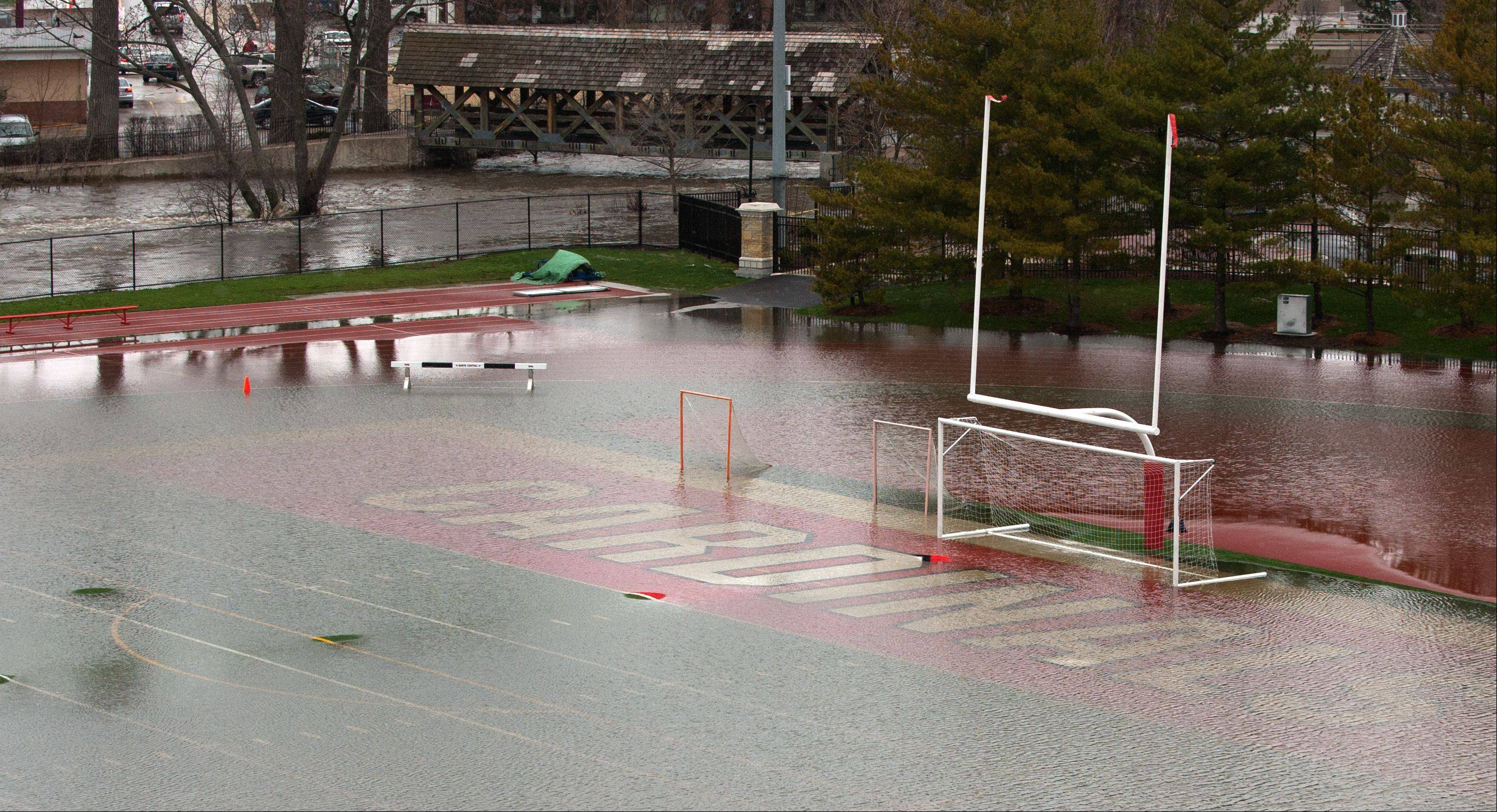 The North Central College athletic field is under water from ravaging downtown Naperville flooding.