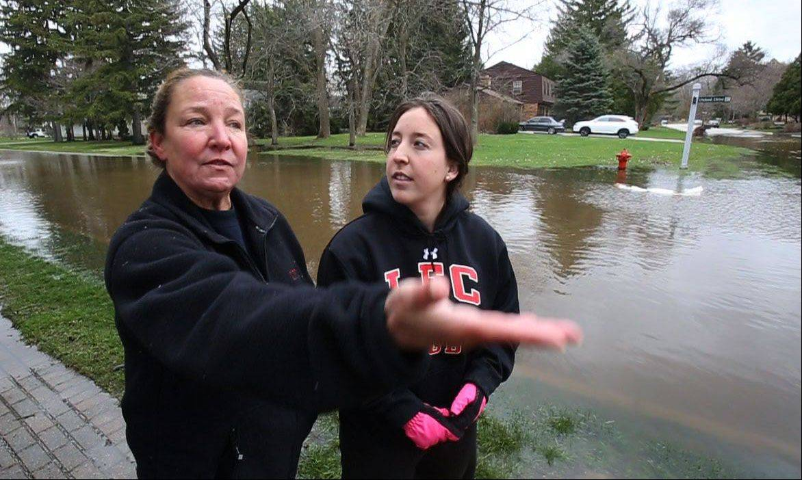 Steve Lundy/slundy@dailyherald.comJanis Swanson, left, and her daughter Emma have never seen the water this high in the 25 years they have lived in Lincolnshire.