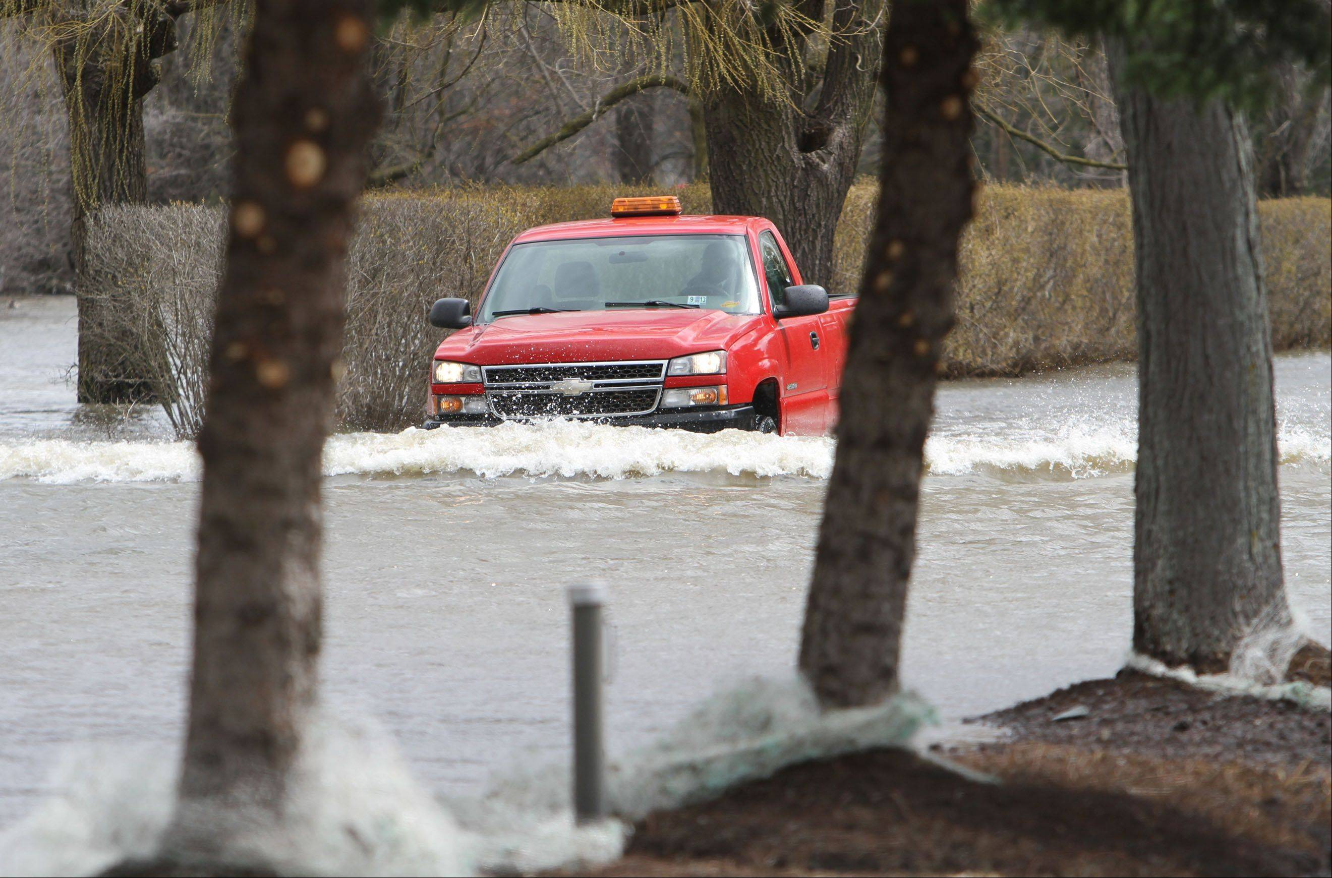 A truck exits the Lincolshire Marriott Resort Friday morning. The resort is closed due to flooding.