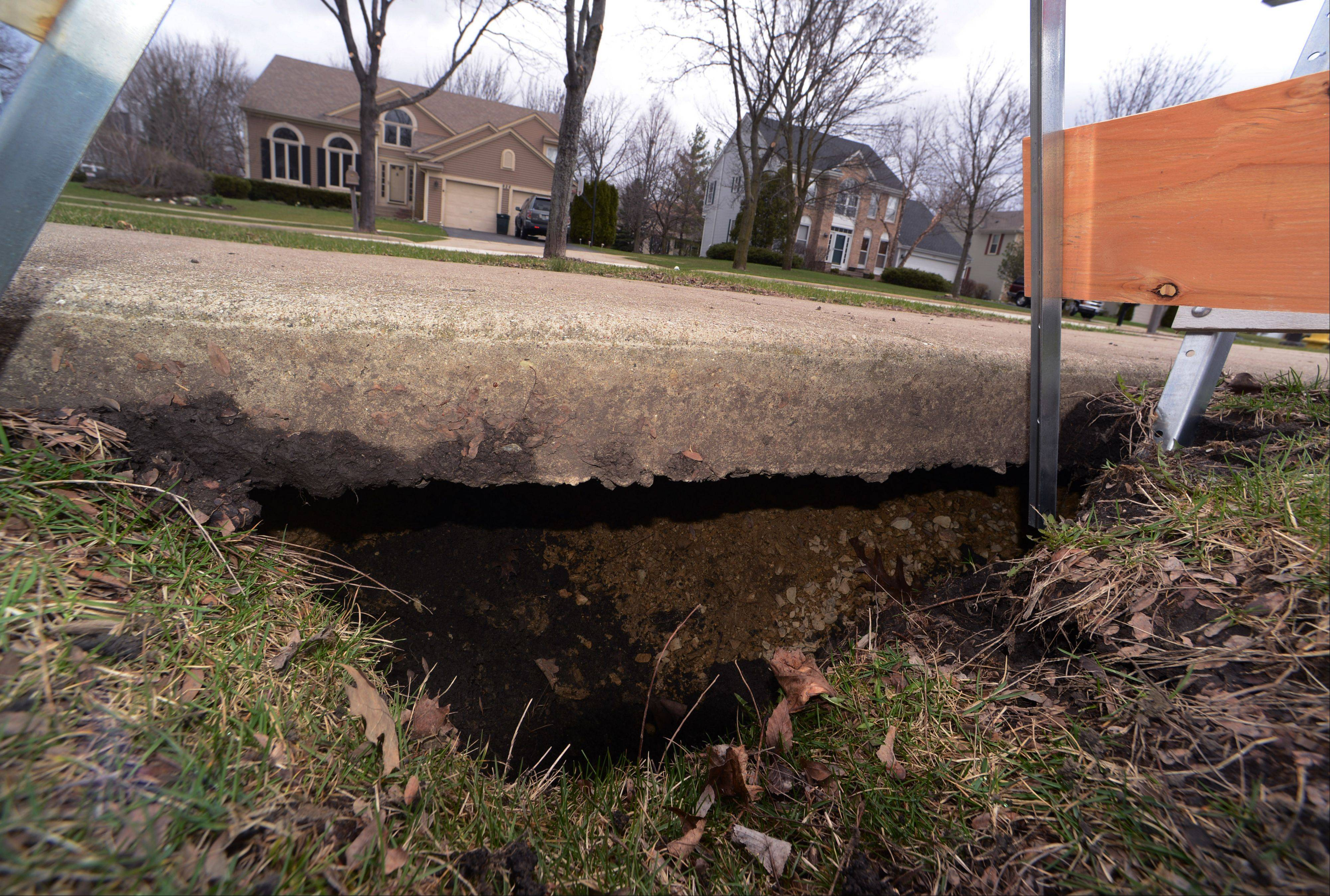 "Mike Finkelman said he may have the first sinkhole ever recorded in Vernon Hills. The 3-foot by 3-foot hole in the 900 block of Saugatuck Trail is ""pretty deep,"" Finkelman said."