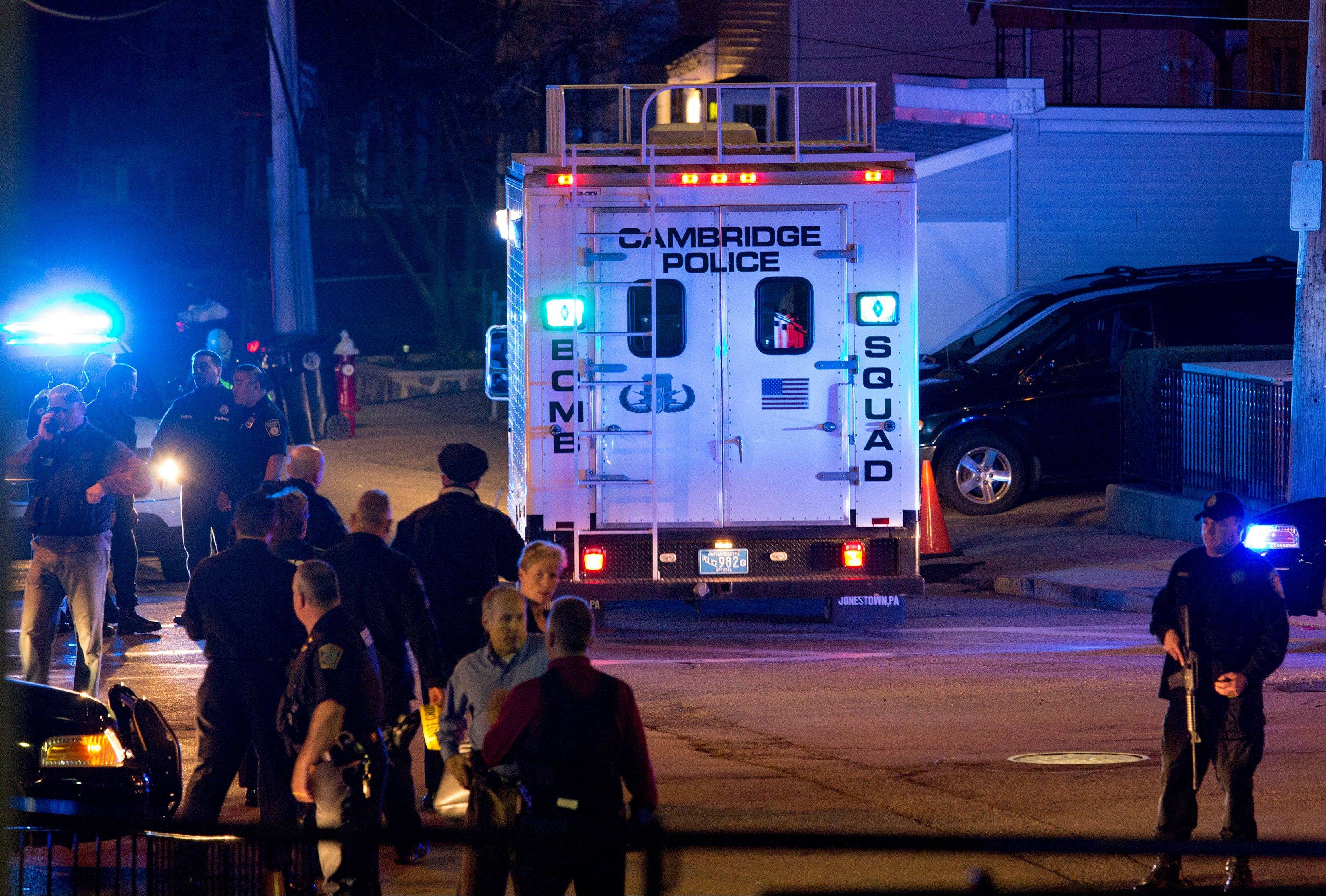 A bomb squad truck arrives at an incident Friday, April 19, 2013, in Watertown, Mass. in which shots were reported to have been fired.