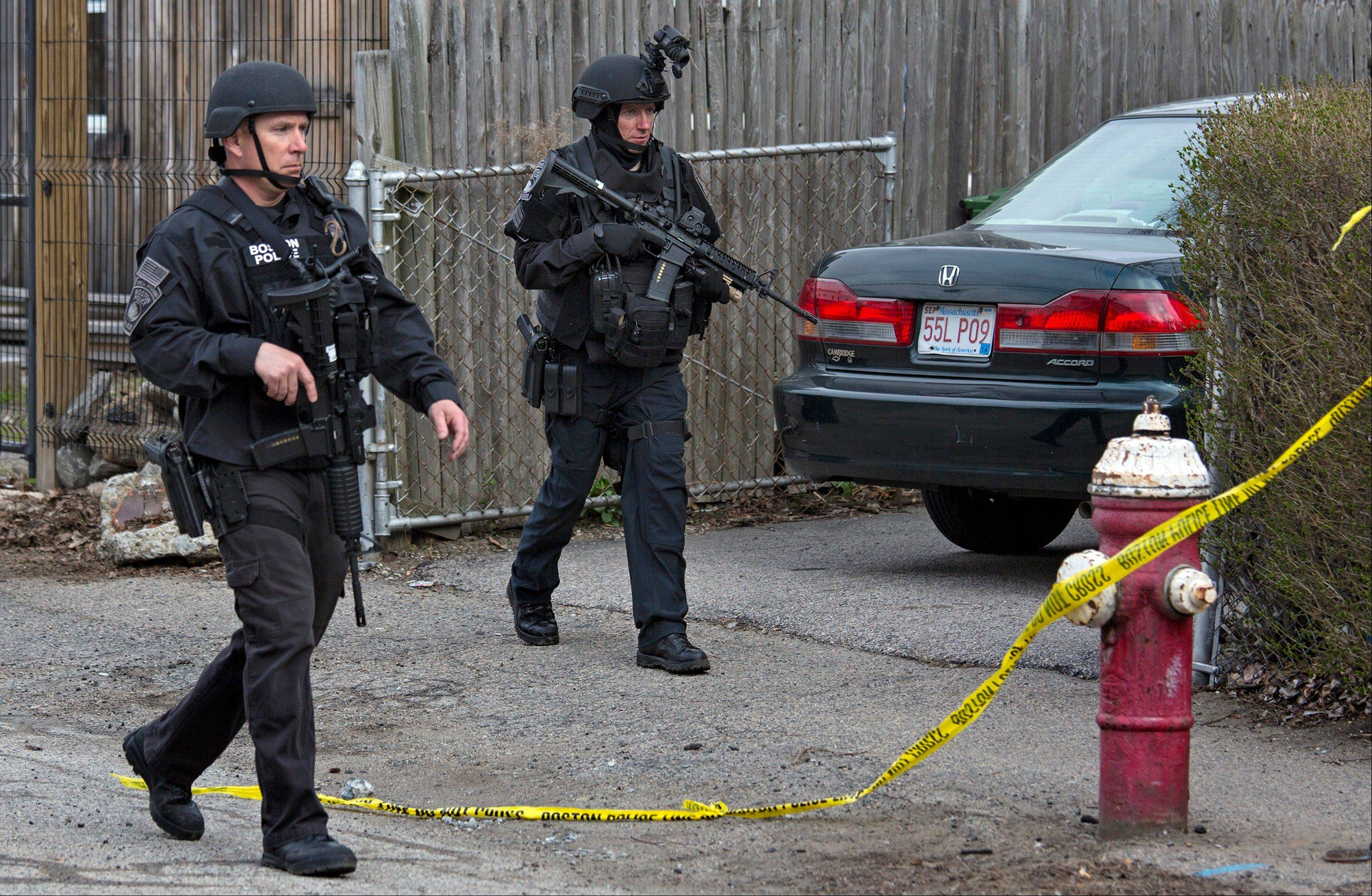 Police continue to patrol the neighborhoods of Watertown, Mass. Friday, April 19, 2013, as a massive search continued for one of two suspects in the Boston Marathon bombing. A second suspect died in the early morning hours after an encounter with law enforcement.