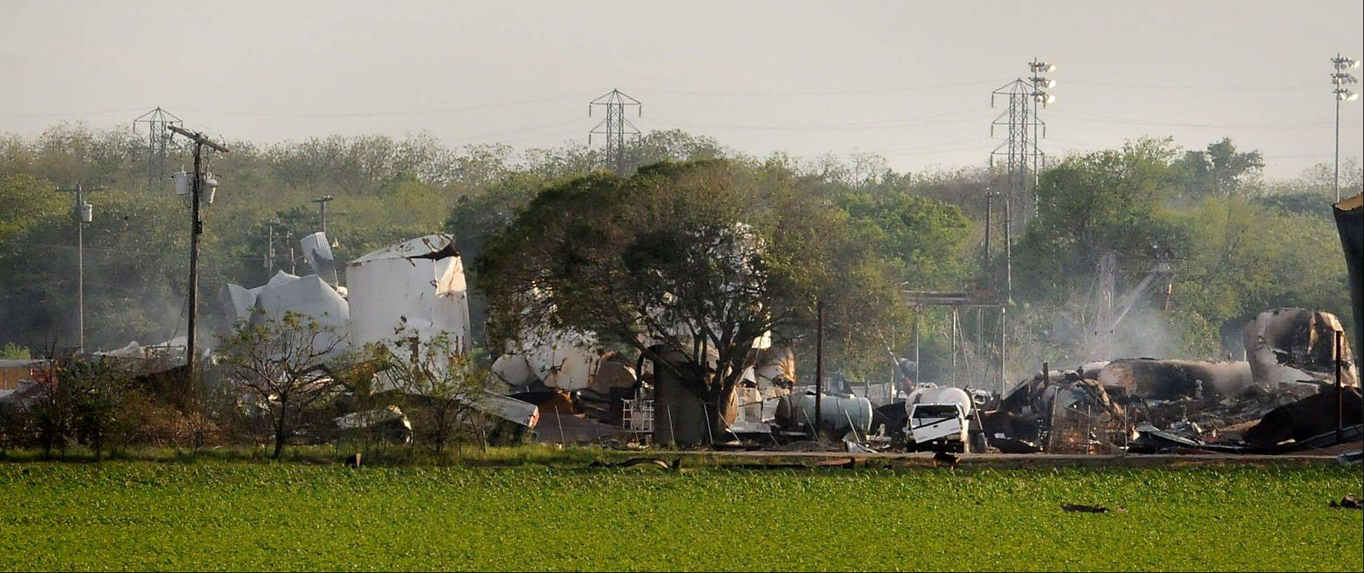 Mangled debris of a fertilizer plant are seen Thursday, April 18, 2013, a day after an explosion leveled the plant in West, Texas. The bodies of 12 people have been recovered. Another 200 other people were injured, authorities said Friday.