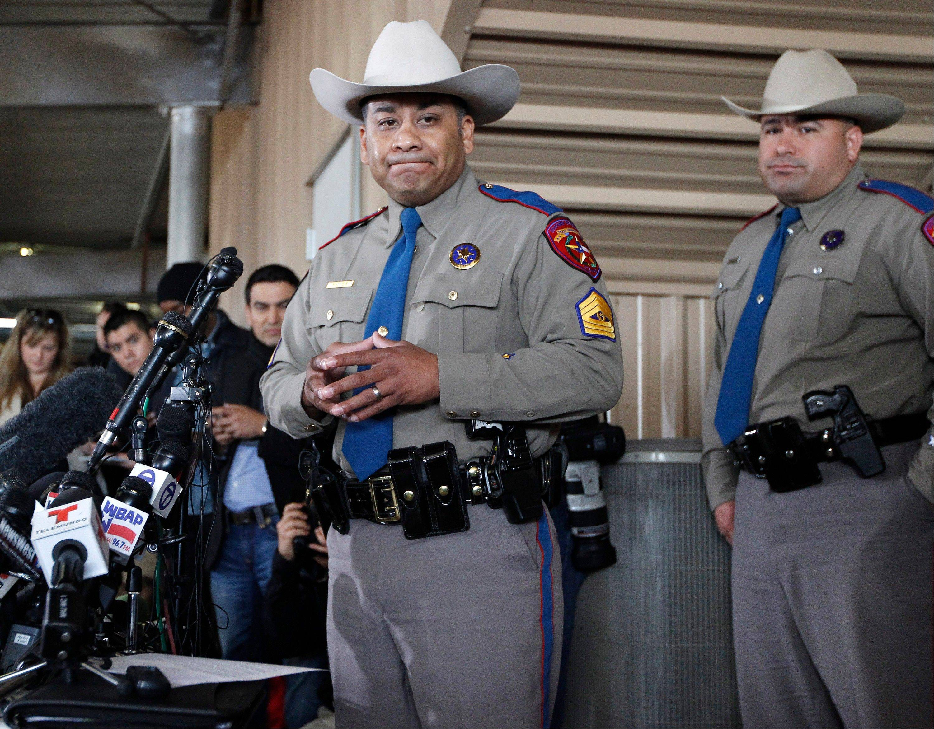 Texas Department of Public Safety Sgt. Jason Reyes, left, and Trooper Noey Fernandez inform reporters that the death toll and the number of destroyed homes during a news conference on Friday April 19, 2013 in West, Texas. The bodies of 12 people have been recovered after an enormous Texas fertilizer plant explosion that demolished surrounding neighborhoods for blocks and left about 200 other people injured, authorities said Friday.