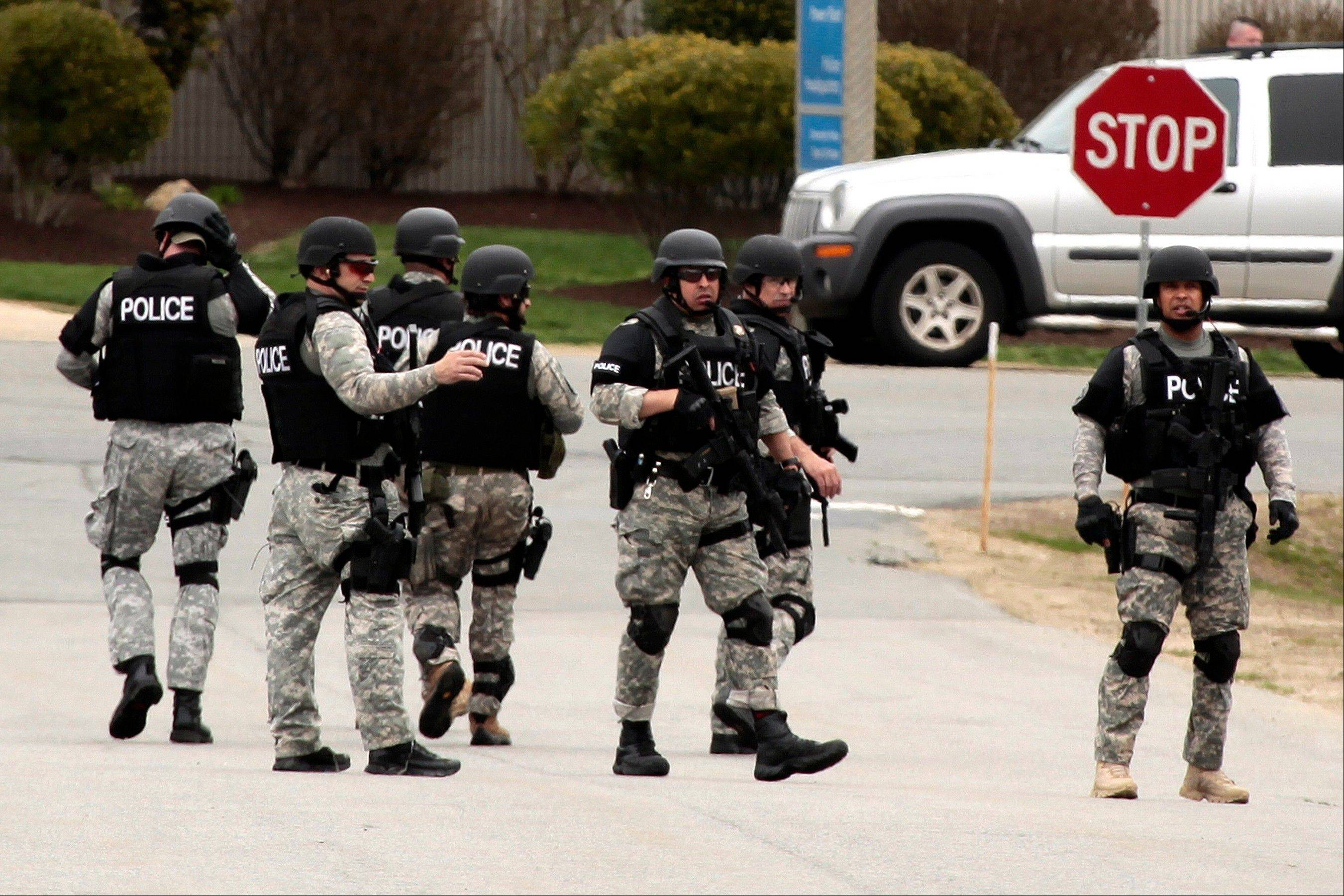 State police move into UMASS Dartmouth on Friday to investigate the dorm room of Dzhokhar Tsarnaev, 19, one of the two suspects wanted for the Boston Marathon bombing.