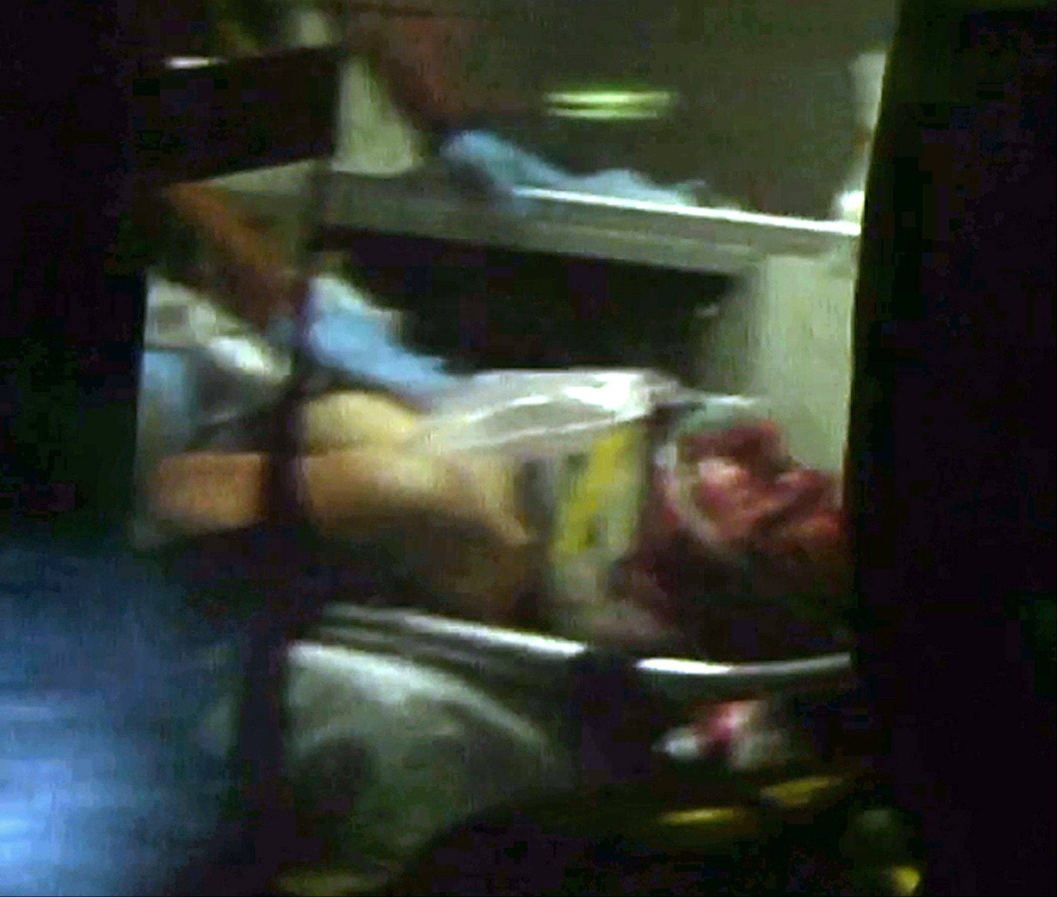 This still frame from video shows Boston Marathon bombing suspect Dzhokhar Tsarnaev visible through an ambulance after he was captured in Watertown, Mass., Friday, April 19, 2013. A 19-year-old college student wanted in the Boston Marathon bombings was taken into custody Friday evening after a manhunt that left the city virtually paralyzed and his older brother and accomplice dead.