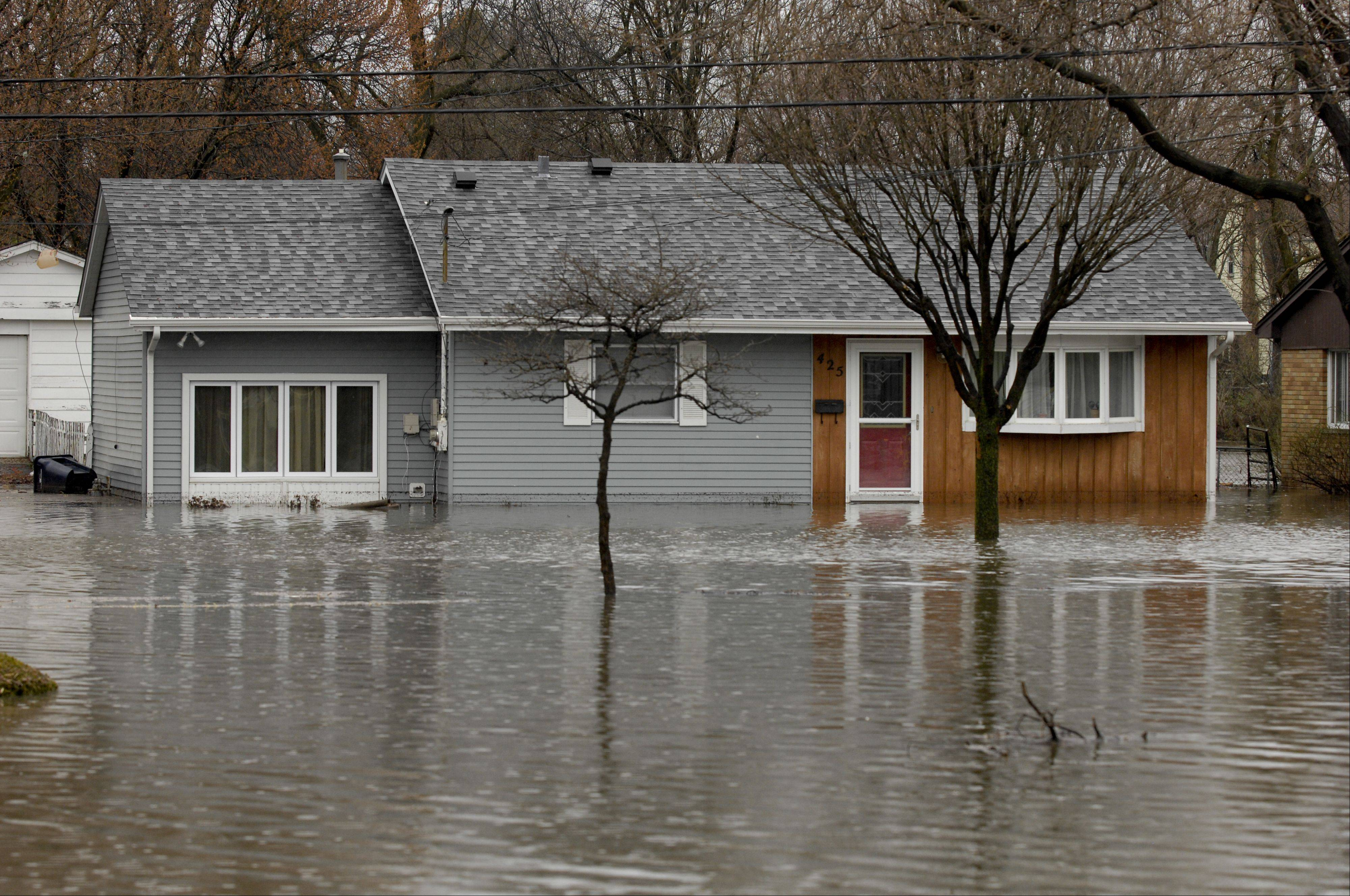 Mark Black/mblack@dailyherald.com The flooded home of Kurt and Debra Langworthy along Finley Road in Lombard Thursday.
