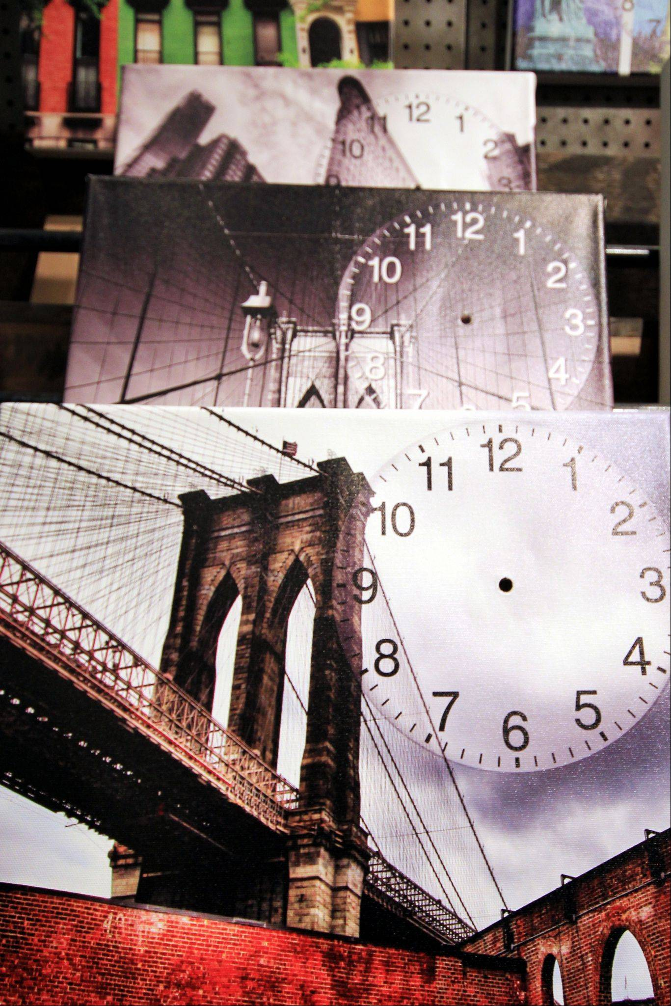I really enjoy photographing souvenir stands. They can capture the essence of a city in a variety of ways. In a shop, for sale were canvas images of NYC ready to be turned into decorative wall clocks. I liked the stacking� of the images and the outline for telling time, without the hands.