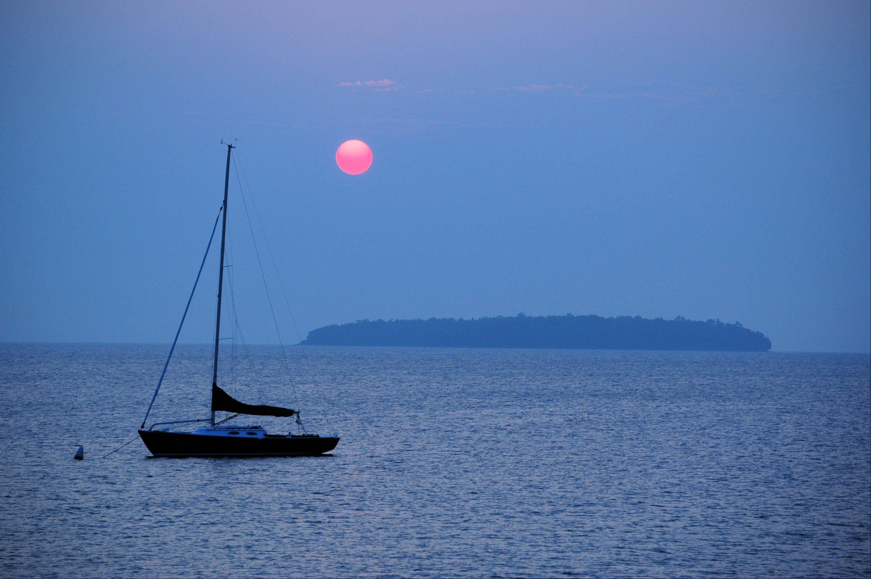 I photographed this tranquil scene of boat, sunset, and island each summer on trips to Ephraim in Door County. Then one summer the boat was gone! Since then, the sunsets from this viewpoint have not felt the same.