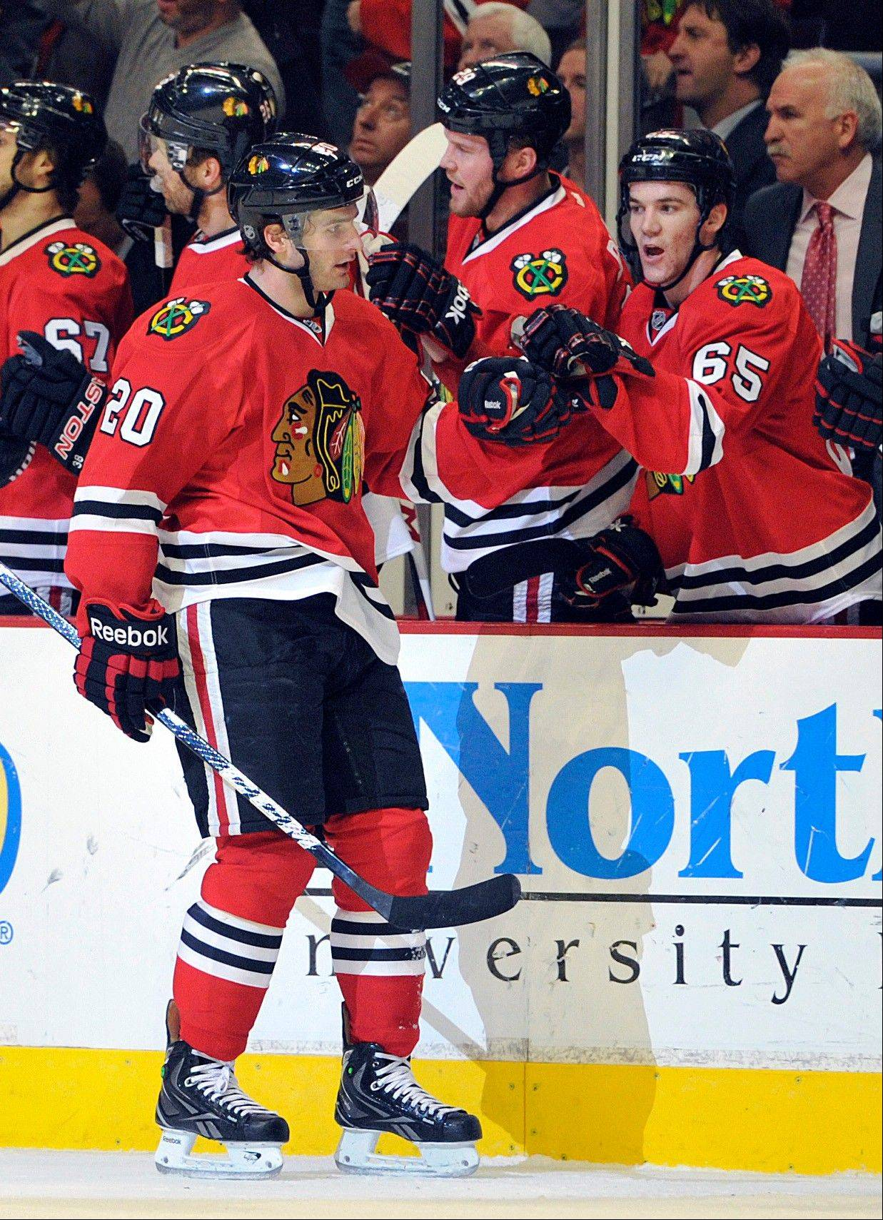 Chicago Blackhawks' Brandon Saad (20) is congratulated by Andrew Shaw after scoring a goal against the Nashville Predators during the first period of an NHL hockey game Friday, April 19, 2013, in Chicago.