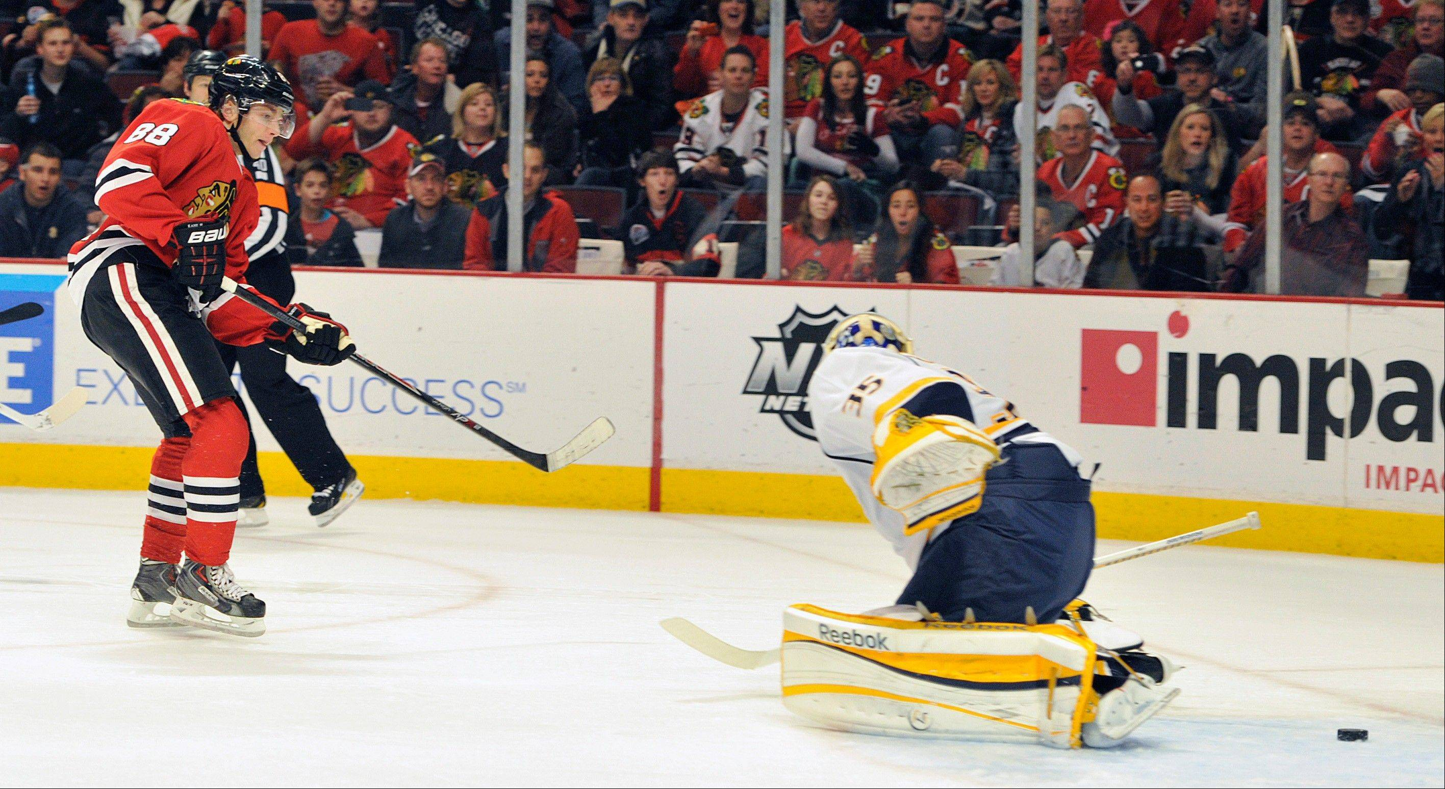 Chicago Blackhawks' Patrick Kane (88) shoots the puck past the Nashville Predators' Pekka Rinne during the second period of an NHL hockey game on Friday, April 19, 2013, in Chicago.