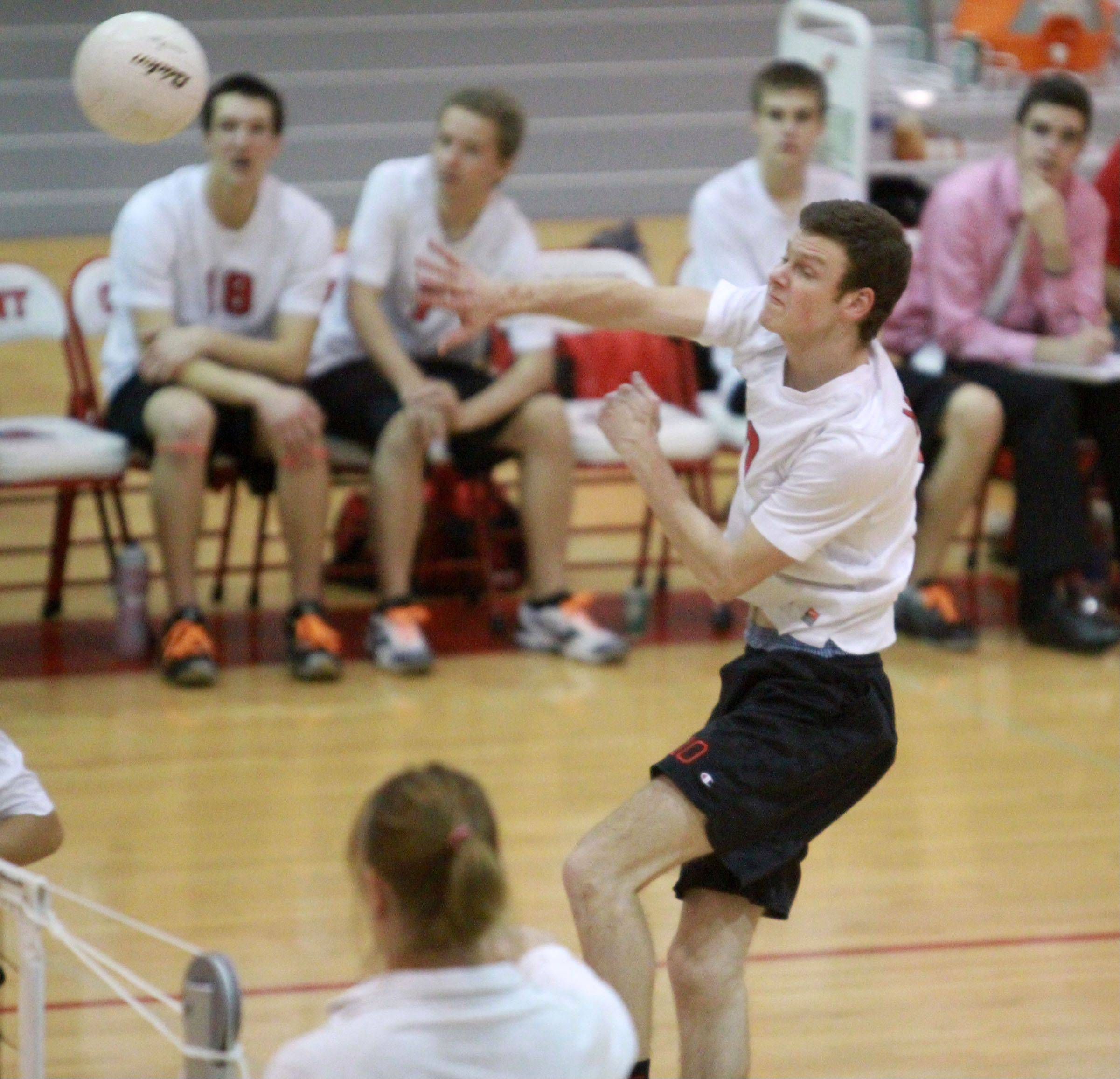 Mundelein's Blake Burton spikes the ball against Grant on Friday.