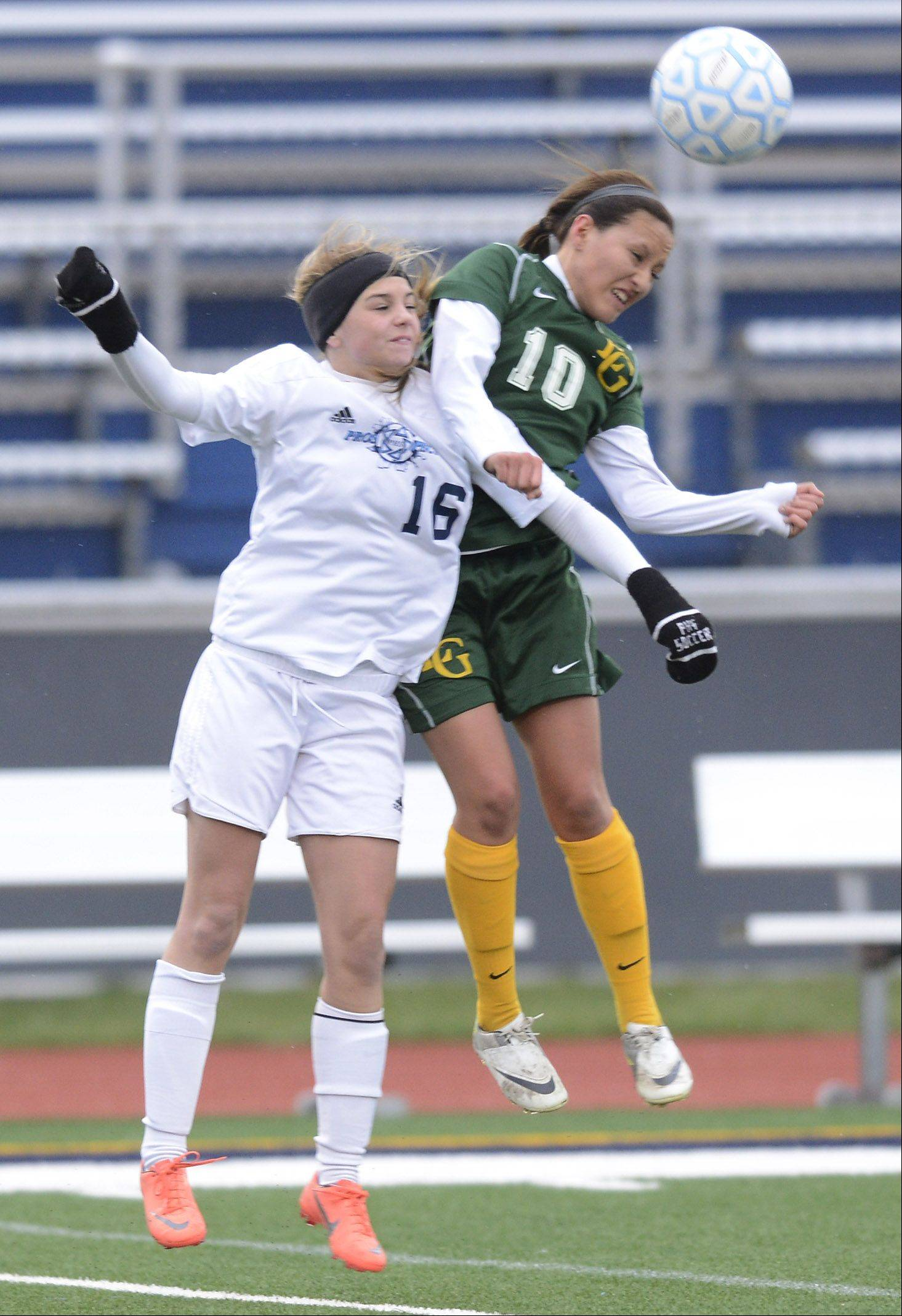Prospect's Andi Marfilius, left, and Elk Grove's Stephanie Solis leap for a header during Friday's game.