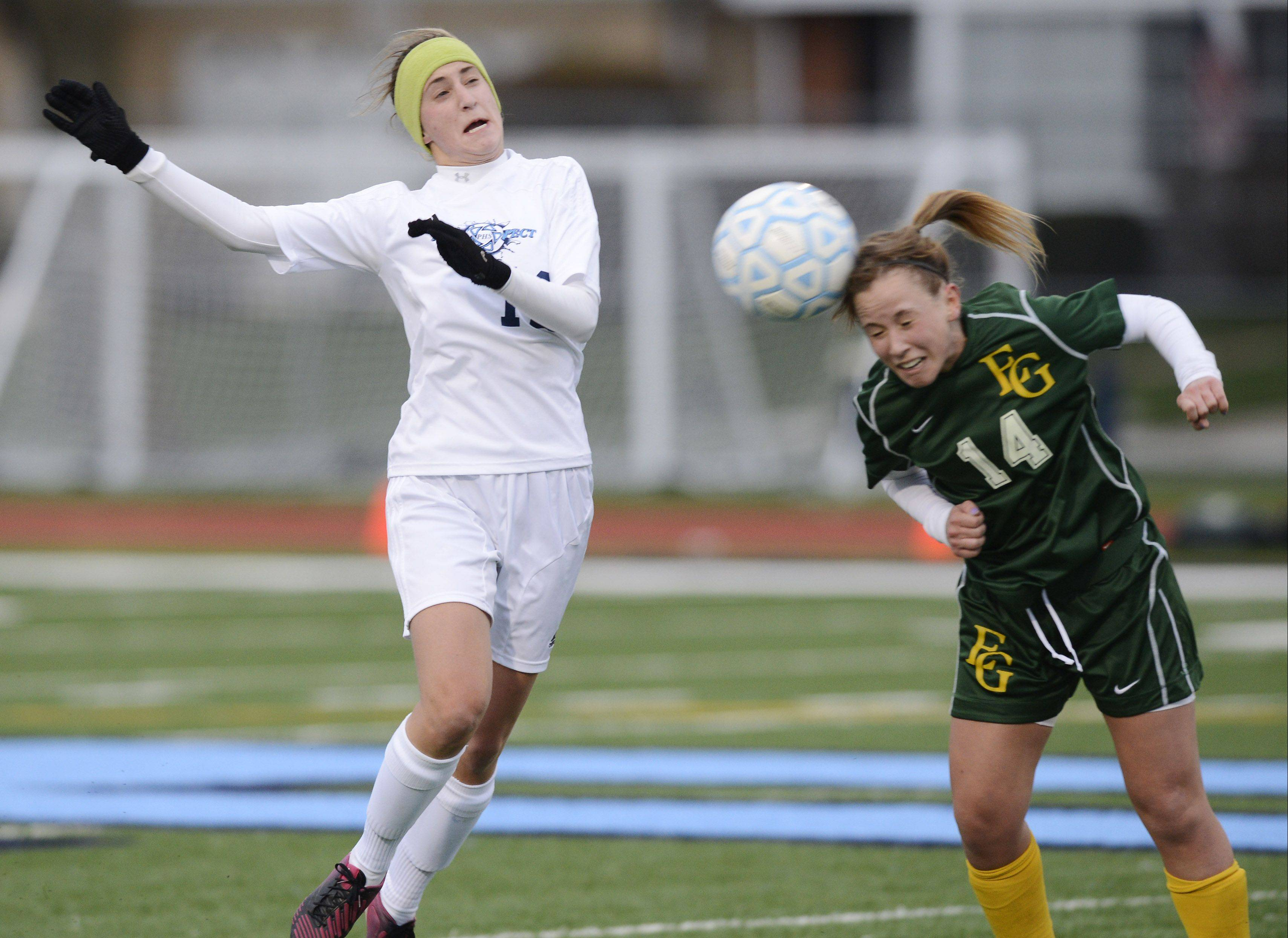 Elk Grove's Kelly Regan, right, directs the ball past Prospect's Emily Novak during Friday's game.