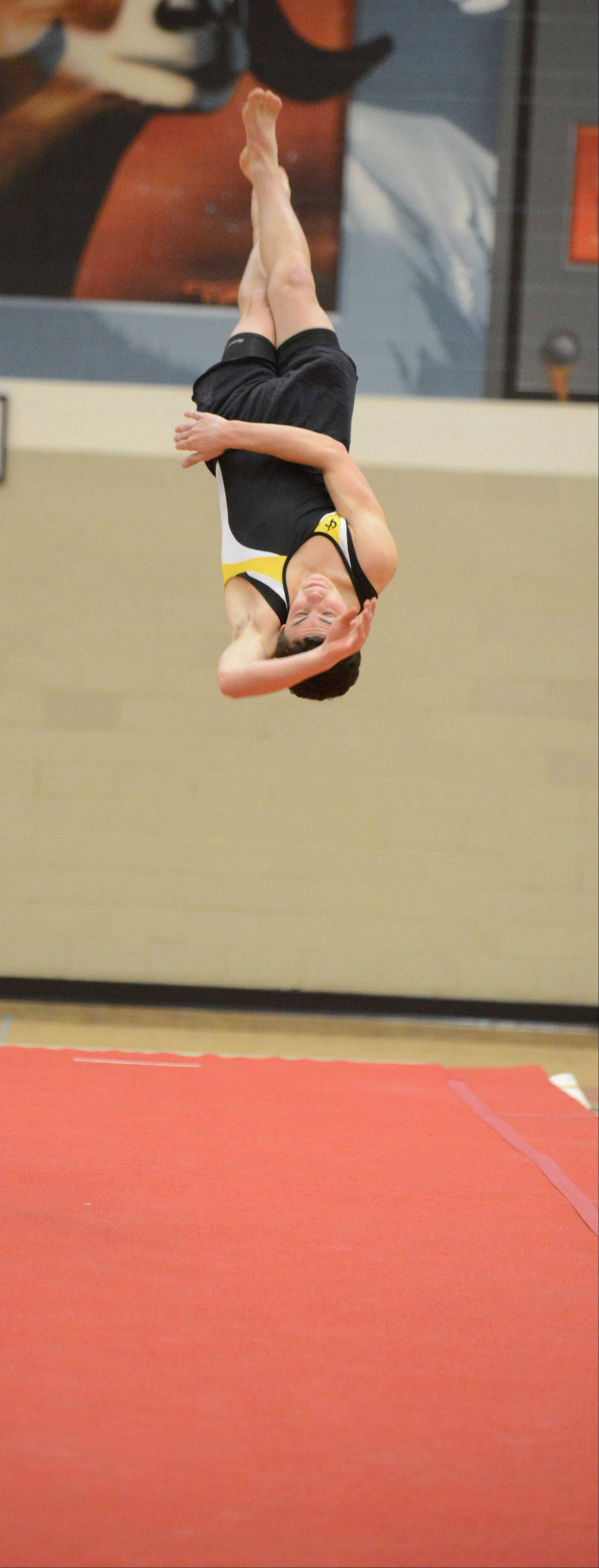 Gino Simone of Glenbard North on the floor during the DuPage Valley Conference boys gymnastics meet at Glenbard East on Friday.
