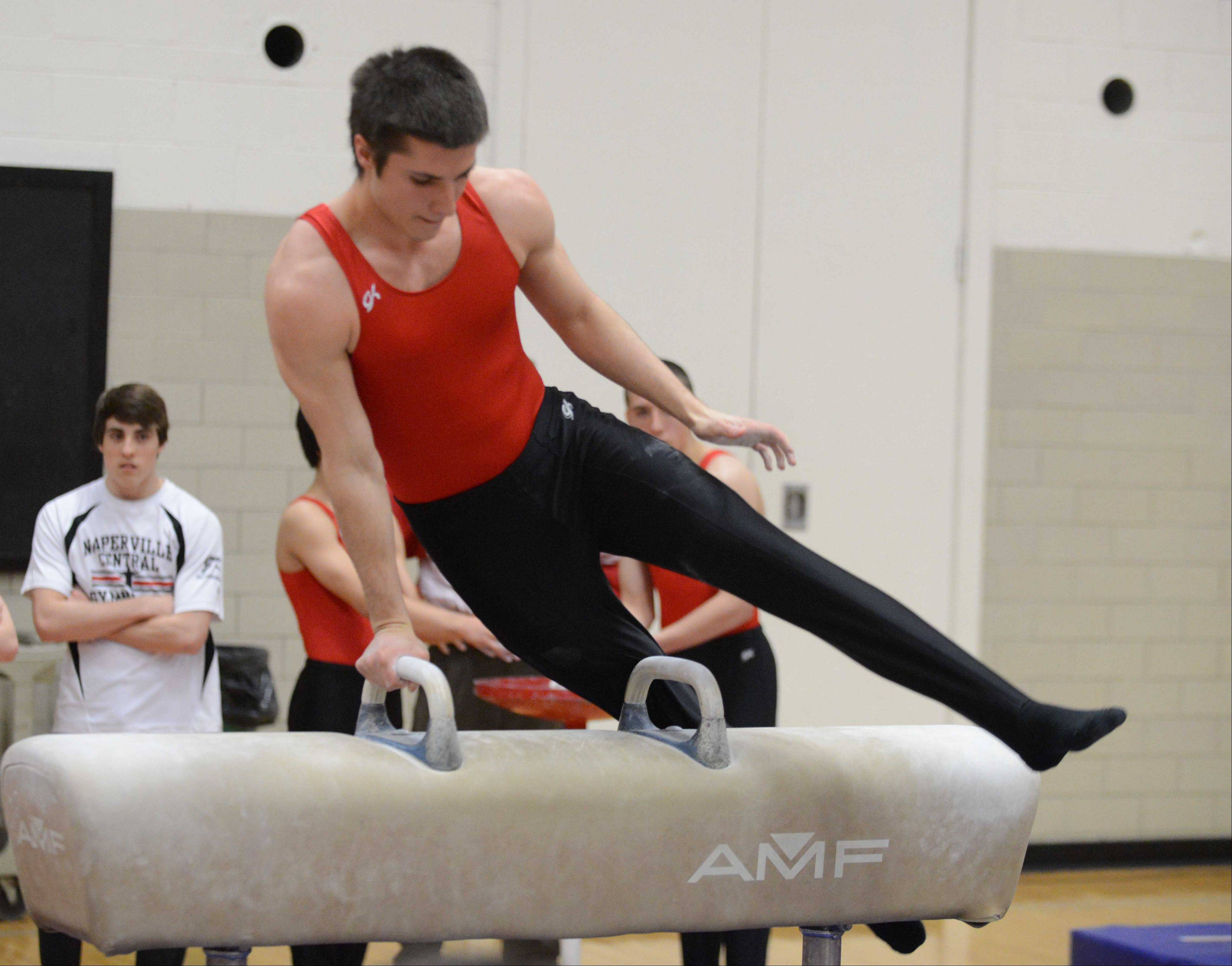 Robert Dietz of Naperville Central on the horse during the DuPage Valley Conference boys gymnastics meet on Friday at Glenbard East.