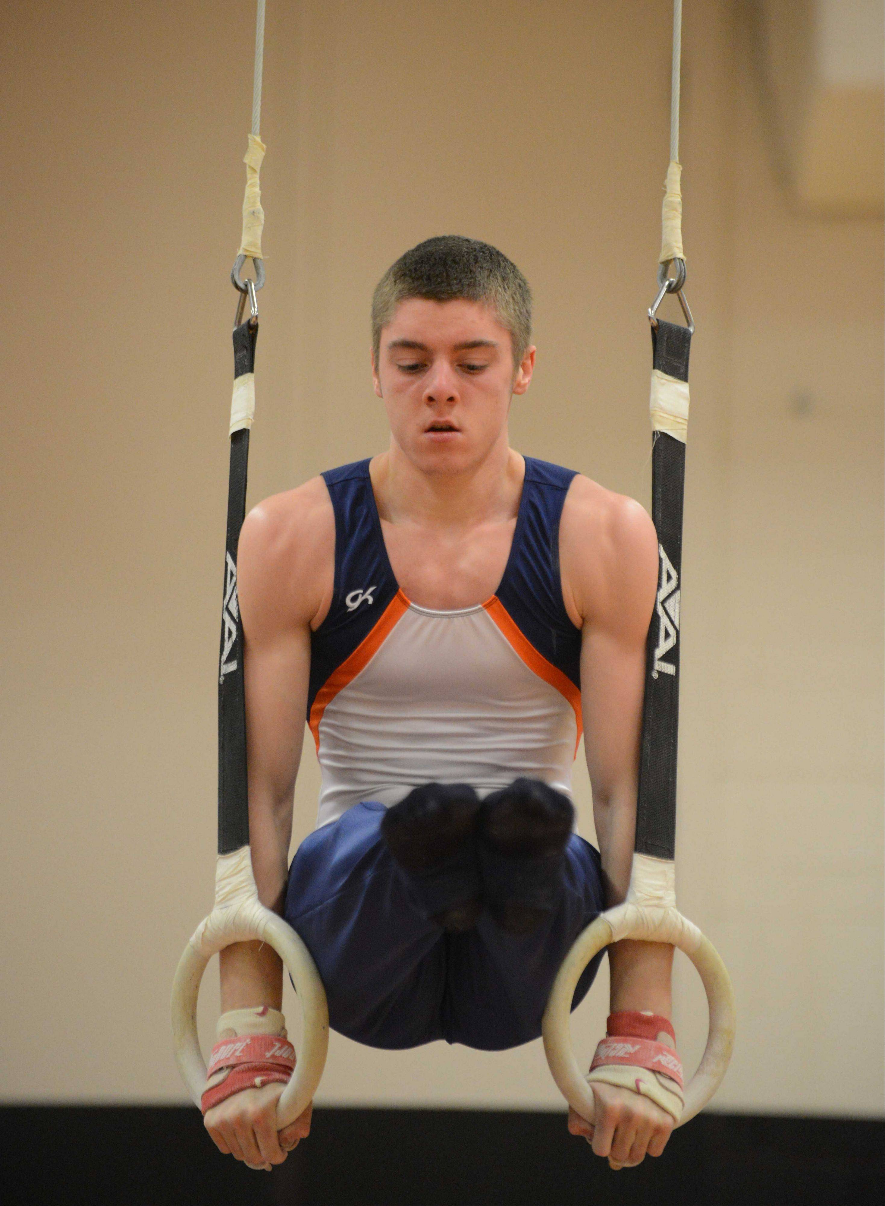 Evan Todd of Naperville North on the rings at the DuPage Valley Conference boys gymnastics at Glenbard East on Friday.