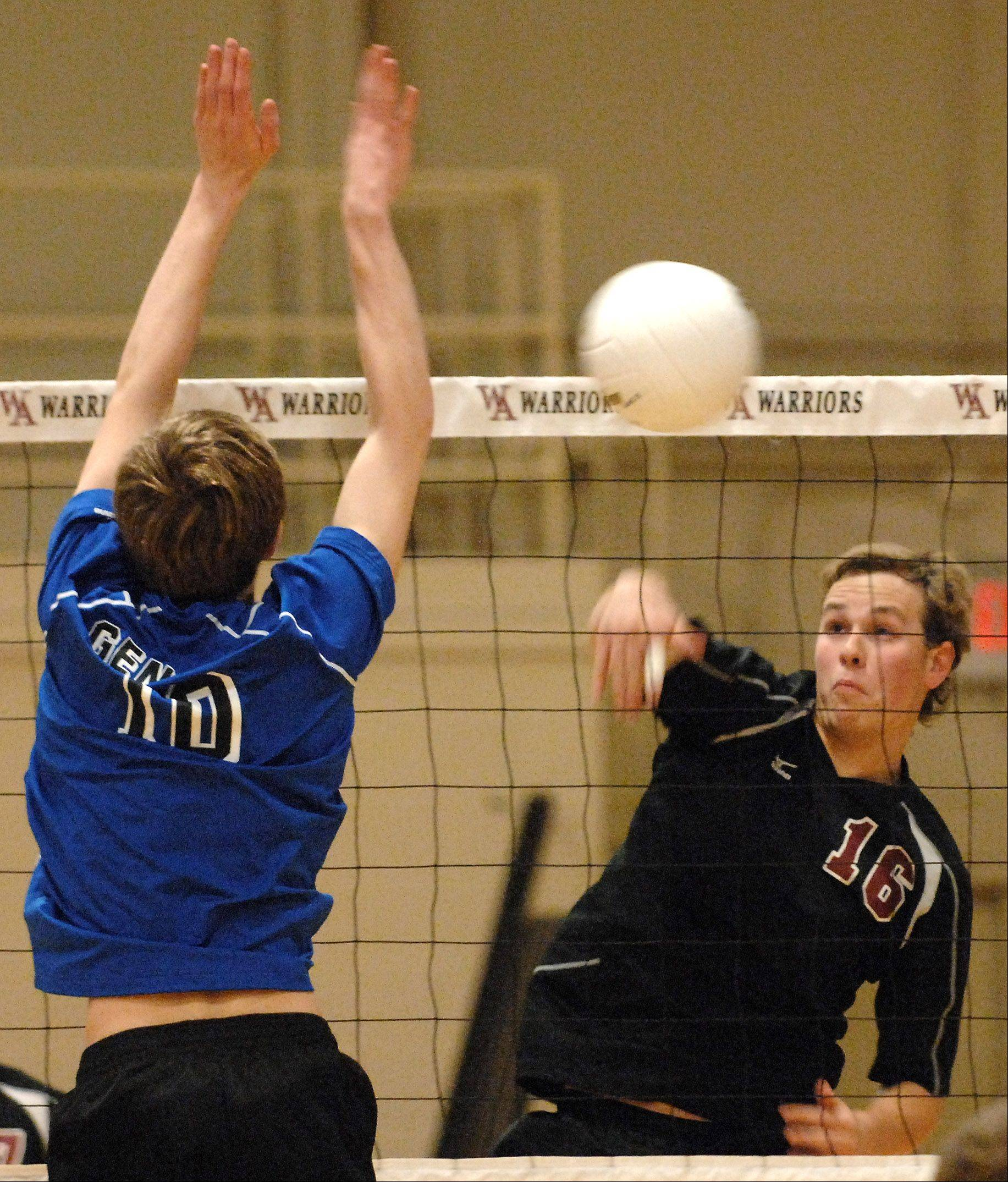 Wheaton Academy's Spencer Graf puts a kill away pass Geneva's Nathan Jesko during volleyball action at Wheaton Academy in West Chicago Friday.