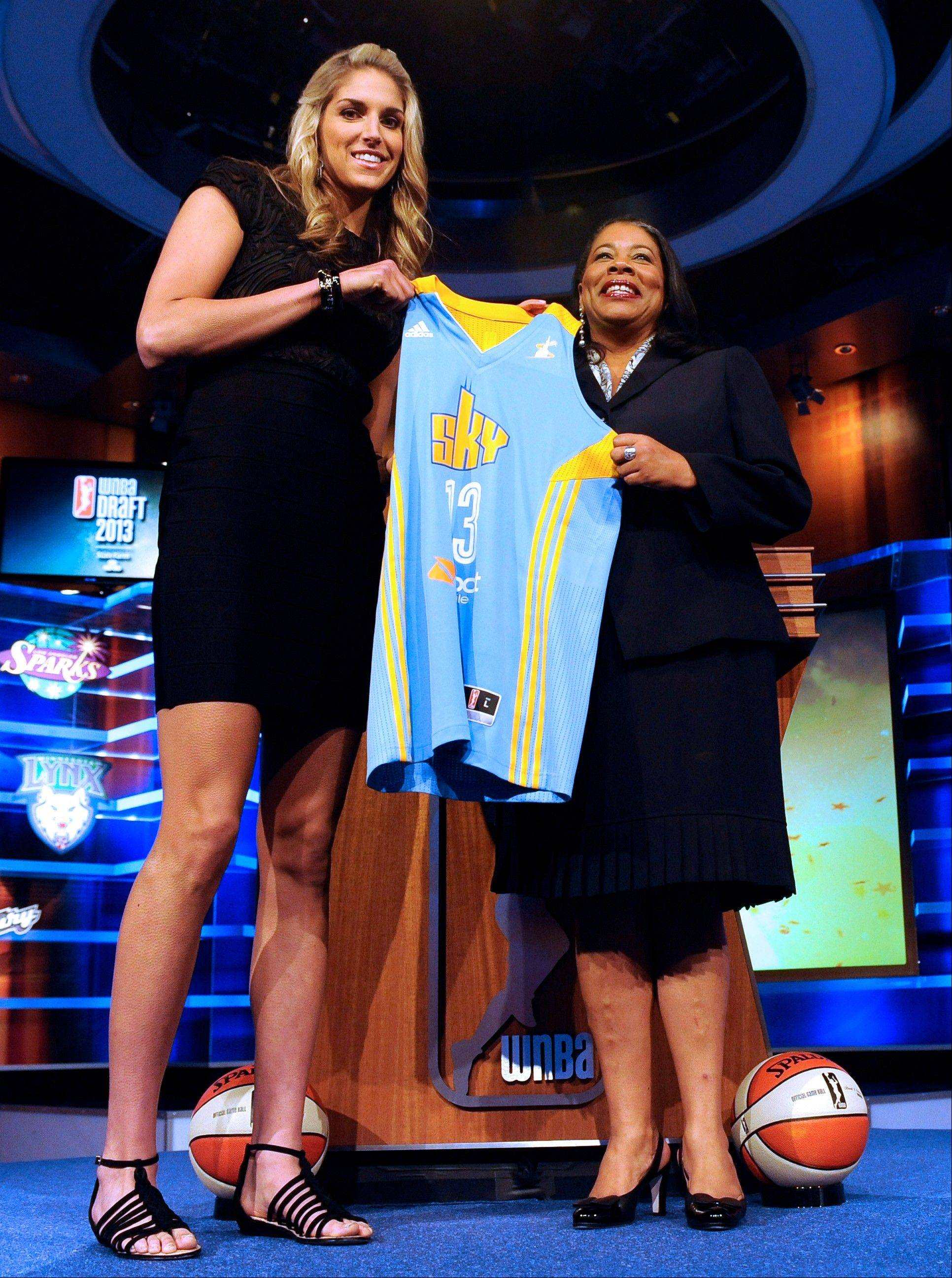 Elena Delle Donne holds up a Chicago Sky jersey with WNBA president Laurel J. Richie the Sky selected Delle Donne as the No. 2 pick in the WNBA draft.