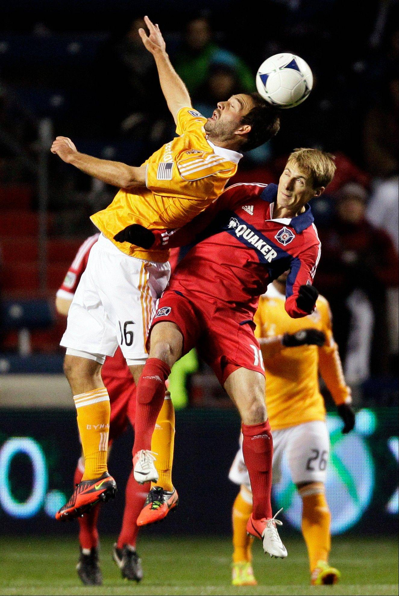 Houston Dynamo midfielder Adam Moffat (16) and Fire forward Chris Rolfe (18) battle for the ball.
