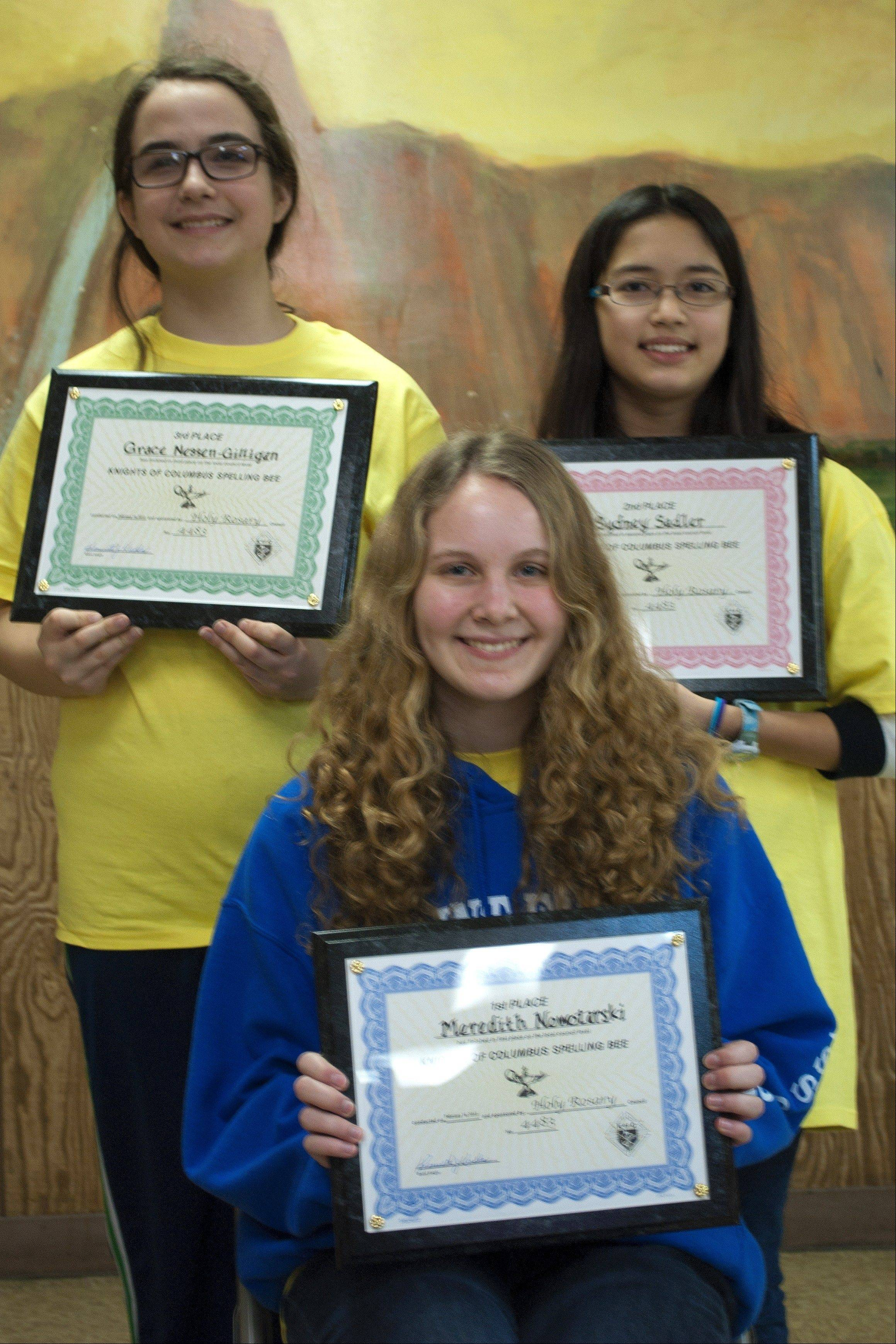 Winners of the 31st annual Knights of Columbus Spelling Bee were: Meredith Nowotarski, seated, first place; and standing, from left, Grace Nessen-Gilligan, third place and Sydney Sadle, second place.