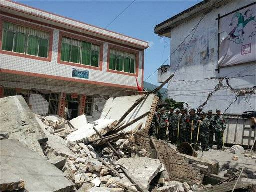 In this photo released by China's Xinhua news agency, buildings are destroyed by a powerful earthquake at Gucheng village of Longmen Township of Lushan County in Ya'an City, southwest China's Sichuan Province, Saturday, April 20, 2013. The powerful earthquake jolted Sichuan province Saturday near where a devastating quake struck five years ago.