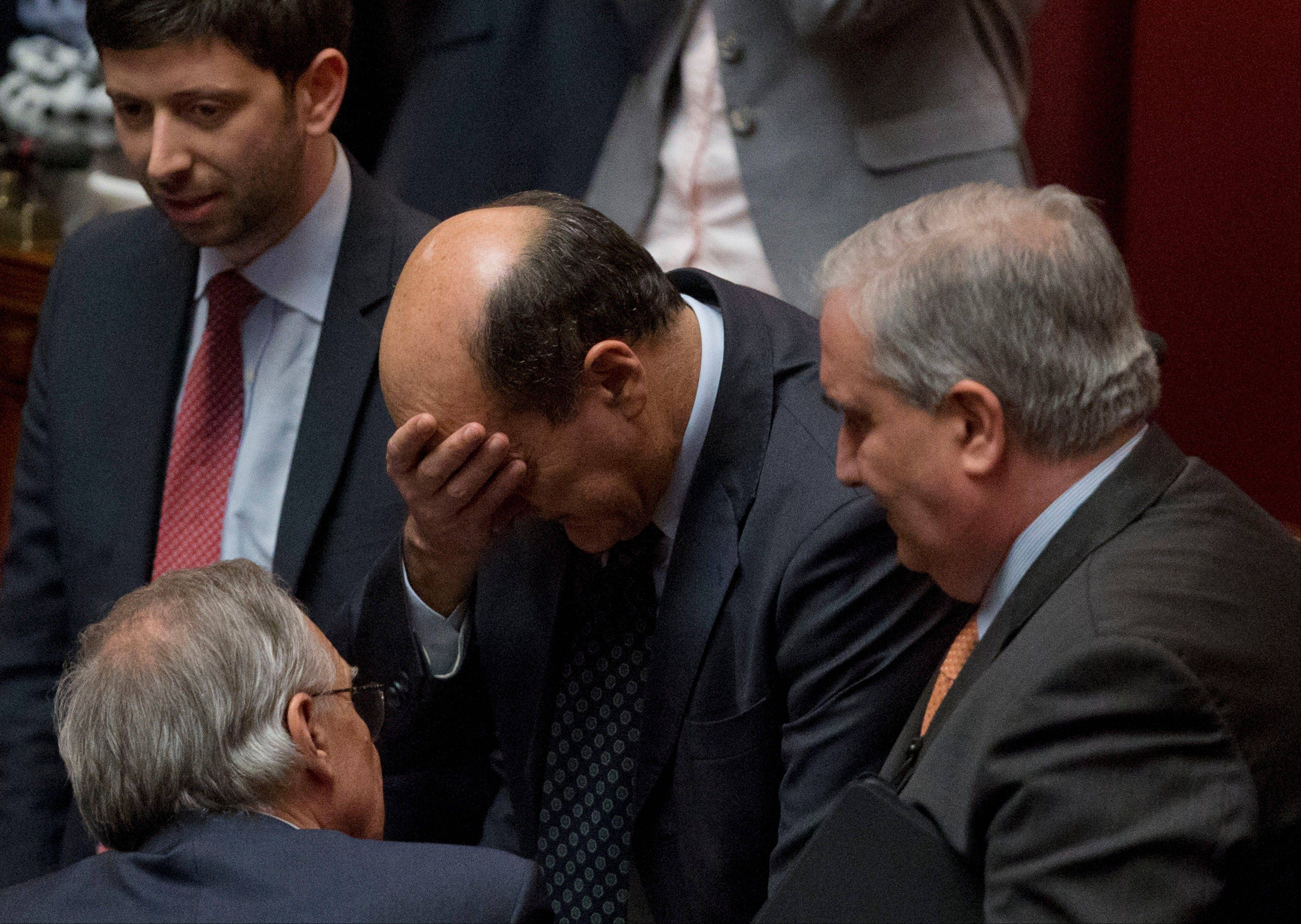 Democratic Party secretary Pierluigi Bersani touches his forehead Saturday after Giorgio Napolitano was elected new Italian head of state, at the Lower Chamber, in Rome.