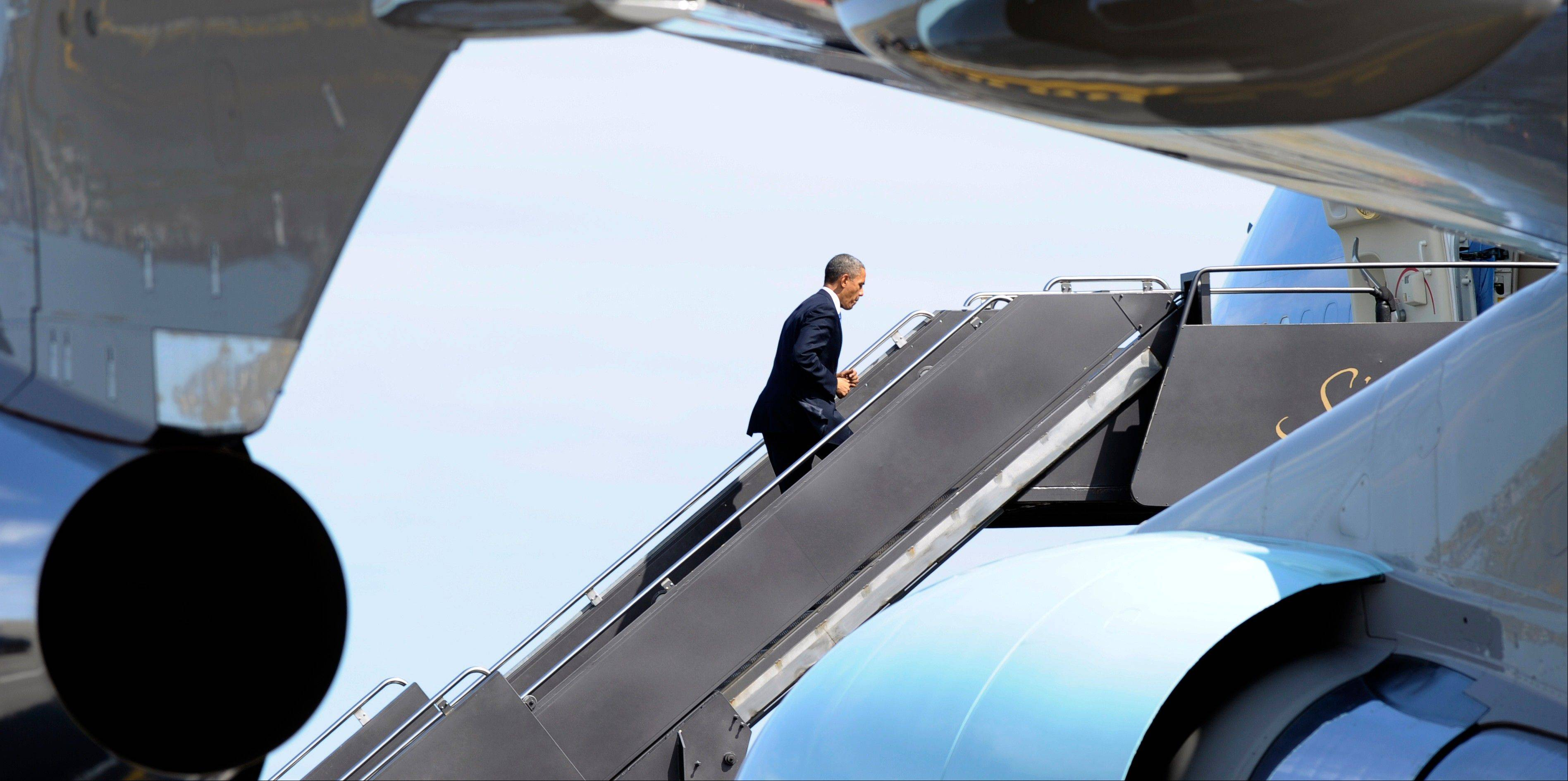 President Barack Obama walks up the steps of Air Force One Thursday at Boston�s Logan International Airport, after attending the �Healing Our City: An Interfaith Service,� dedicated to those who were gravely wounded or killed in Monday�s bombing near the finish line of the Boston Marathon.