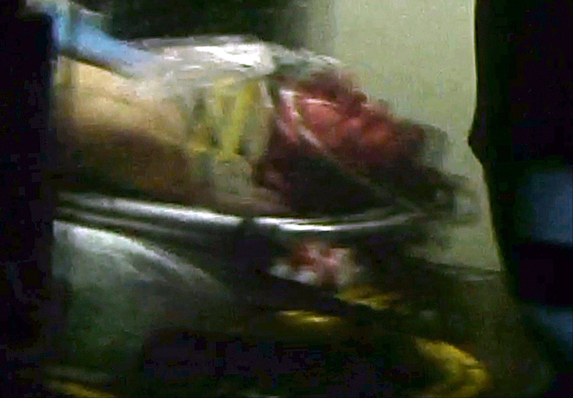 This still frame from video shows Boston Marathon bombing suspect Dzhokhar Tsarnaev visible through an ambulance after he was captured in Watertown, Mass., Friday, April 19, 2013. The 19-year-old college student wanted in the Boston Marathon bombings was taken into custody Friday evening after a manhunt that left the city virtually paralyzed and his older brother and accomplice dead.