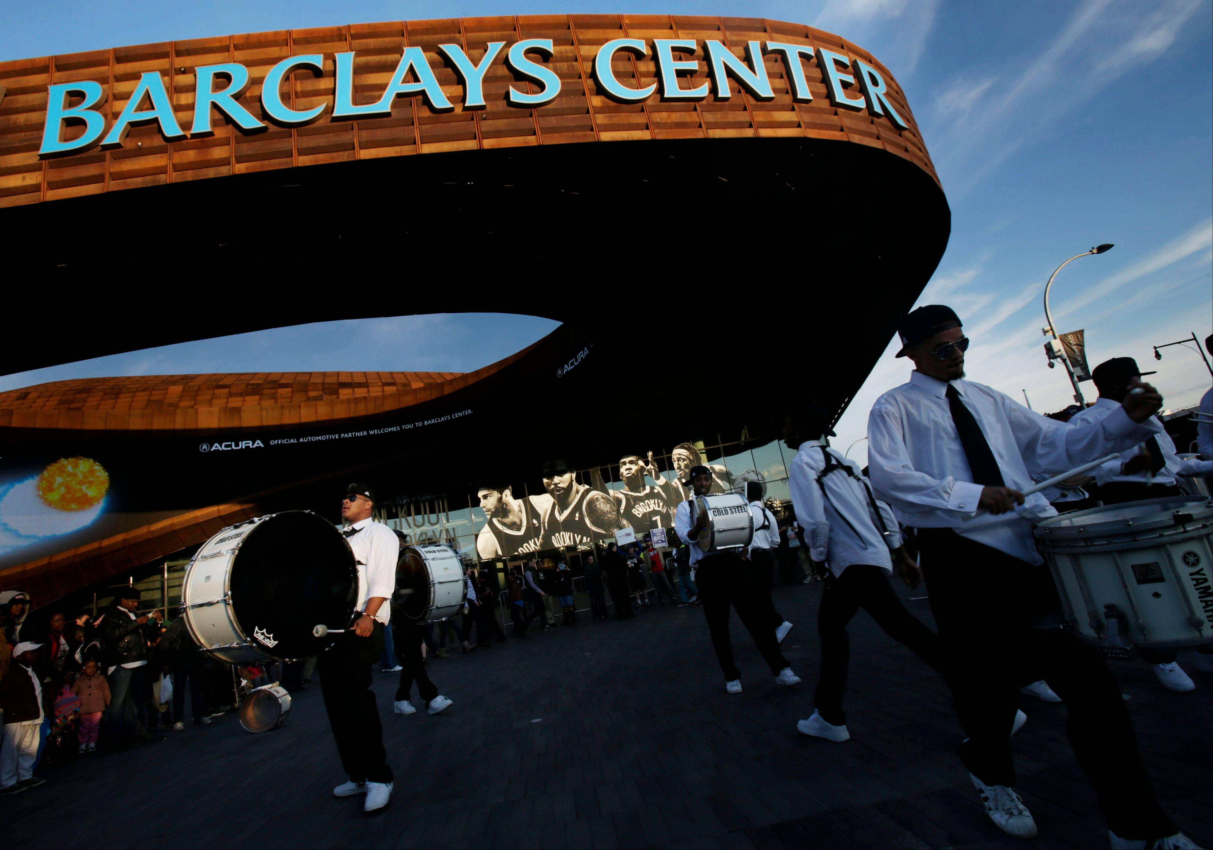 A drum line plays outside of the Barclays Center before the start of Game 1 in the first round of the NBA basketball playoffs between the Chicago Bulls and the Brooklyn Nets Saturday, April 20, 2013 in New York.
